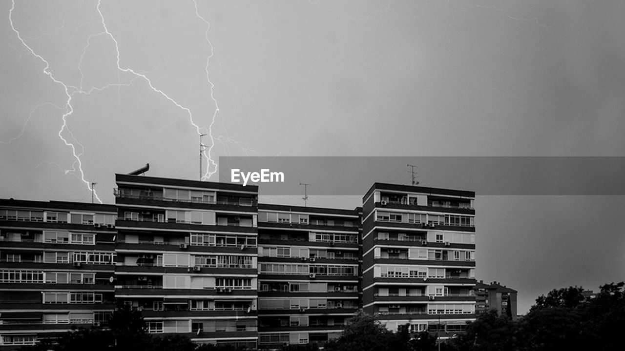 storm, lightning, thunderstorm, weather, danger, power in nature, forked lightning, storm cloud, outdoors, nature, no people, architecture, city, sky, day