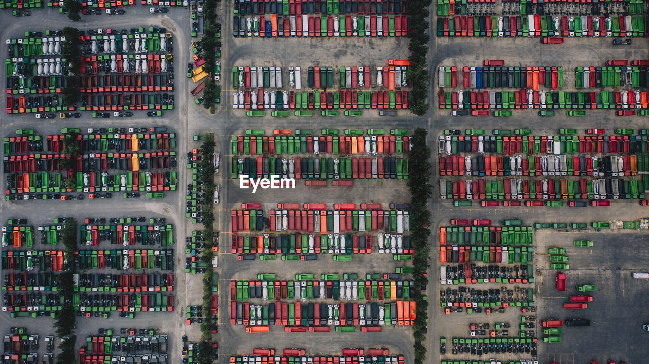 Aerial view of trucks parked in row on land