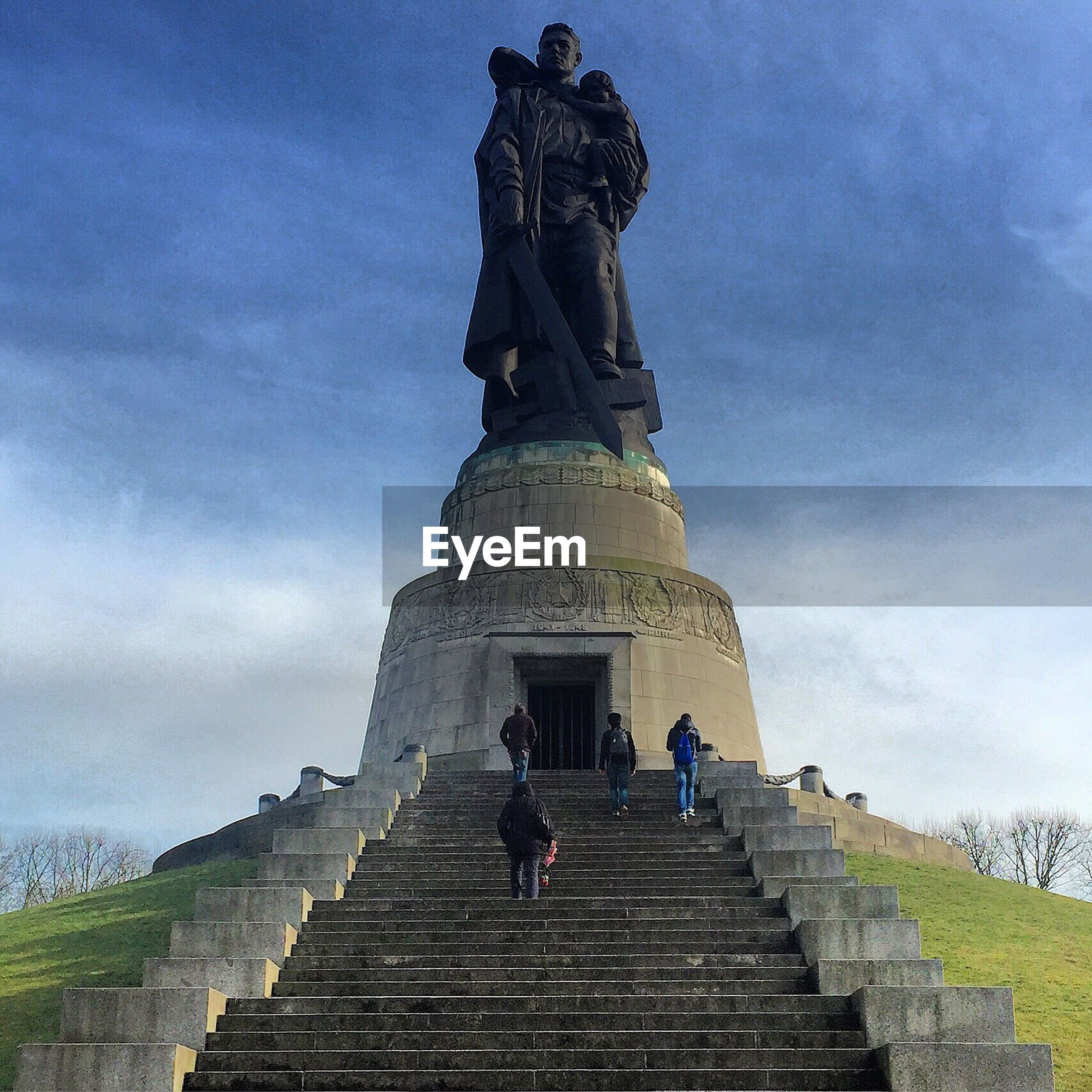 Low angle view of people visiting soviet war memorial in treptower park
