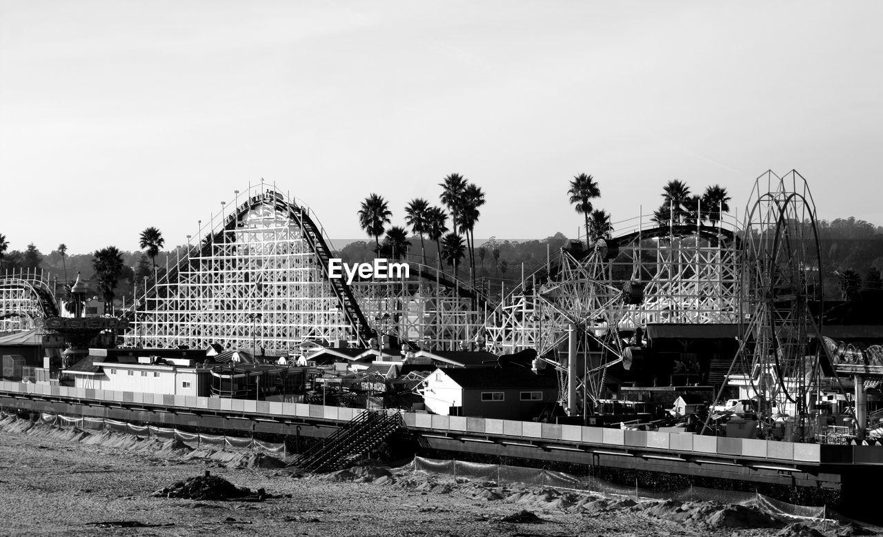 Amusement Park Rides Against Sky