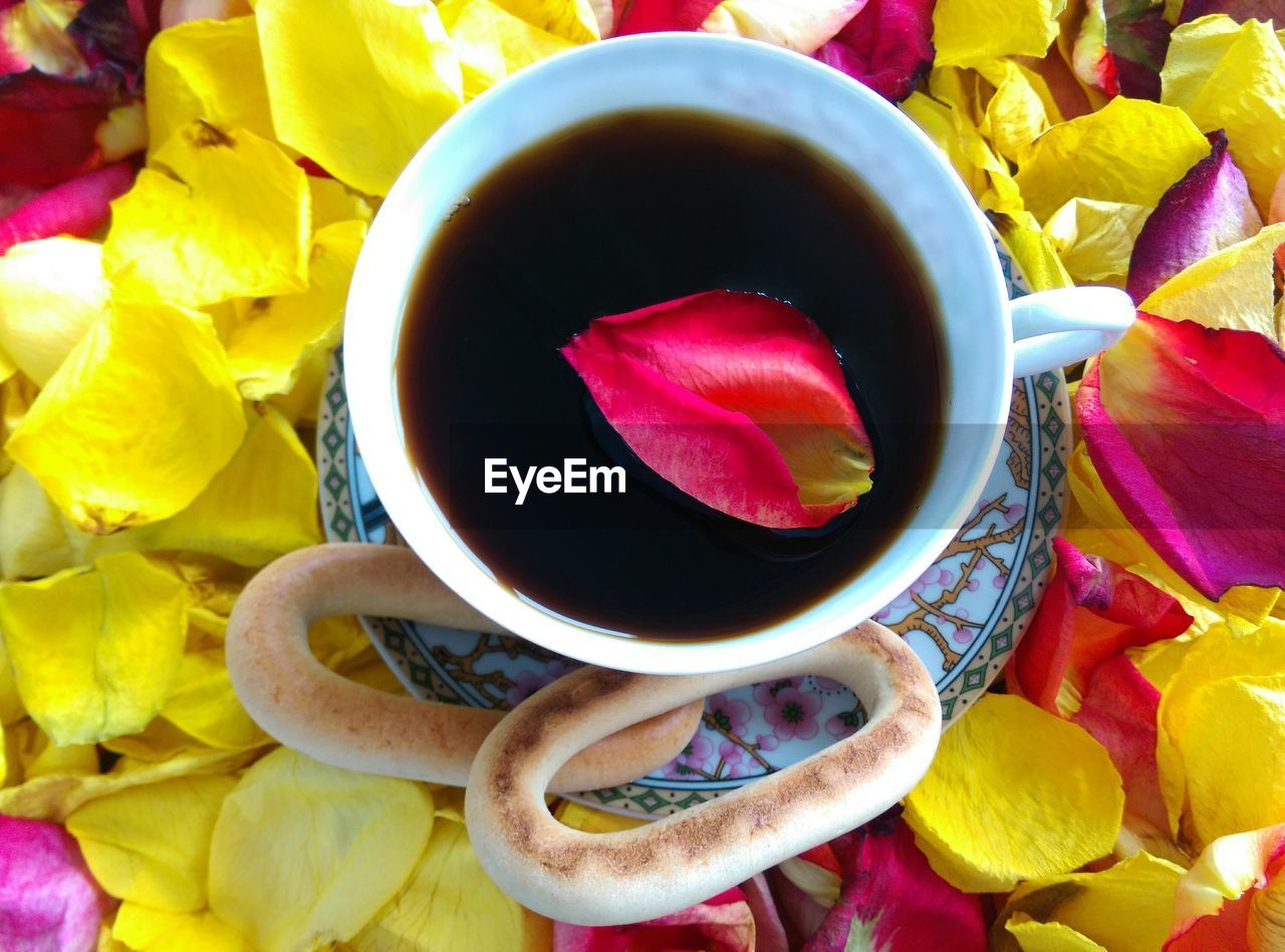 food and drink, refreshment, drink, cup, freshness, flower, indoors, close-up, tea - hot drink, directly above, healthy eating, no people, high angle view, table, petal, multi colored, yellow, food, herbal tea, day
