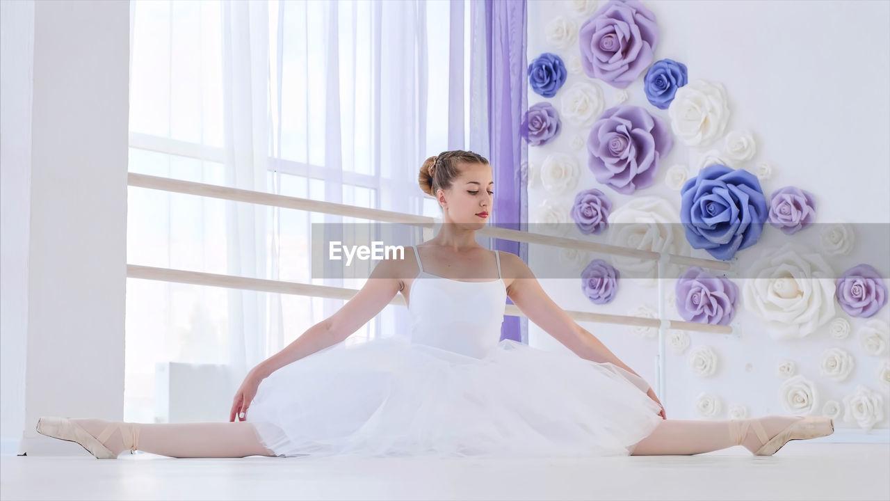 Young woman practicing ballet in studio