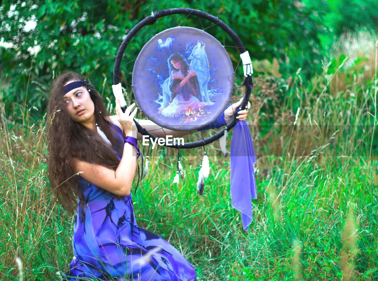plant, bubble, one person, real people, grass, nature, land, three quarter length, holding, long hair, day, young adult, women, bubble wand, field, young women, leisure activity, standing, lifestyles, hairstyle, outdoors, purple