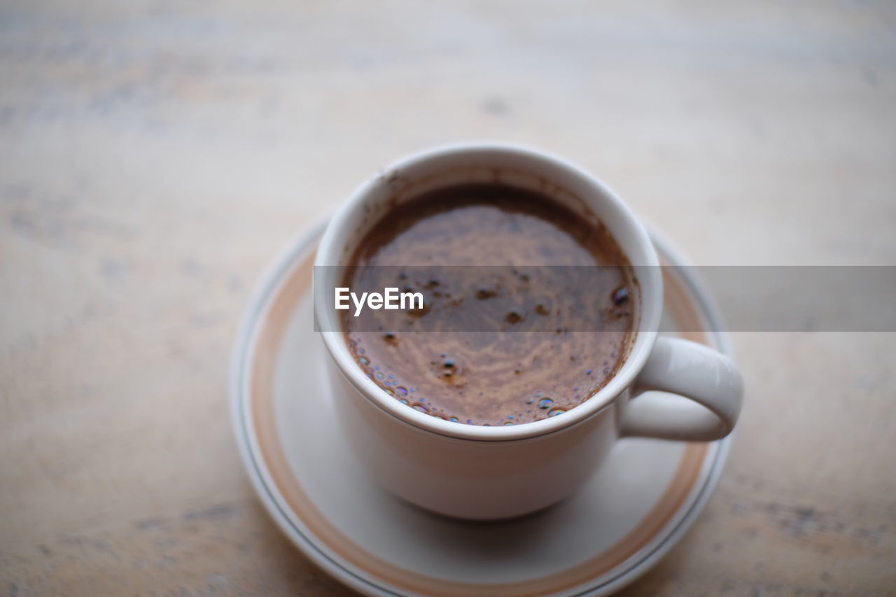 refreshment, drink, cup, food and drink, coffee, coffee - drink, mug, coffee cup, table, crockery, saucer, still life, close-up, freshness, focus on foreground, indoors, frothy drink, no people, hot drink, high angle view, non-alcoholic beverage, tea cup, froth