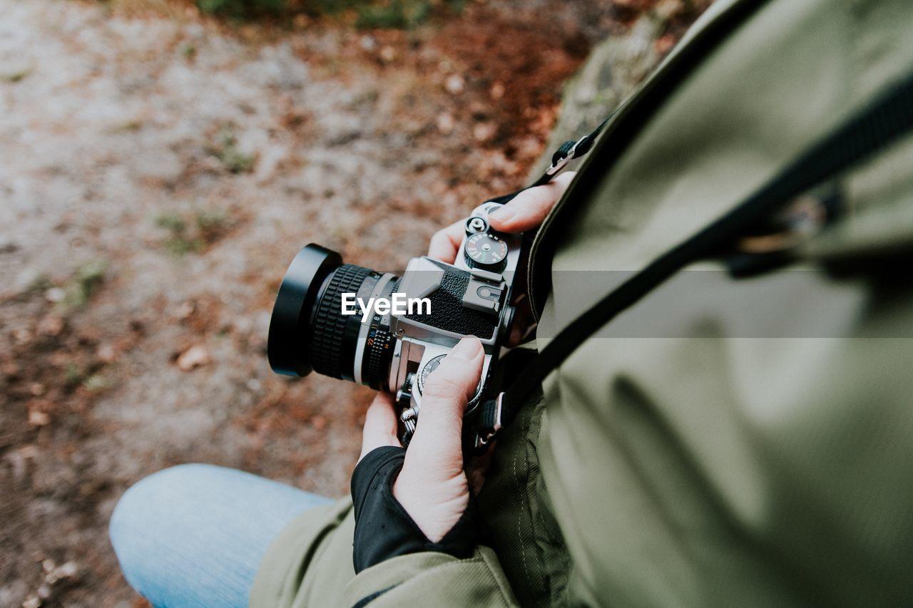 Close-up of man with camera