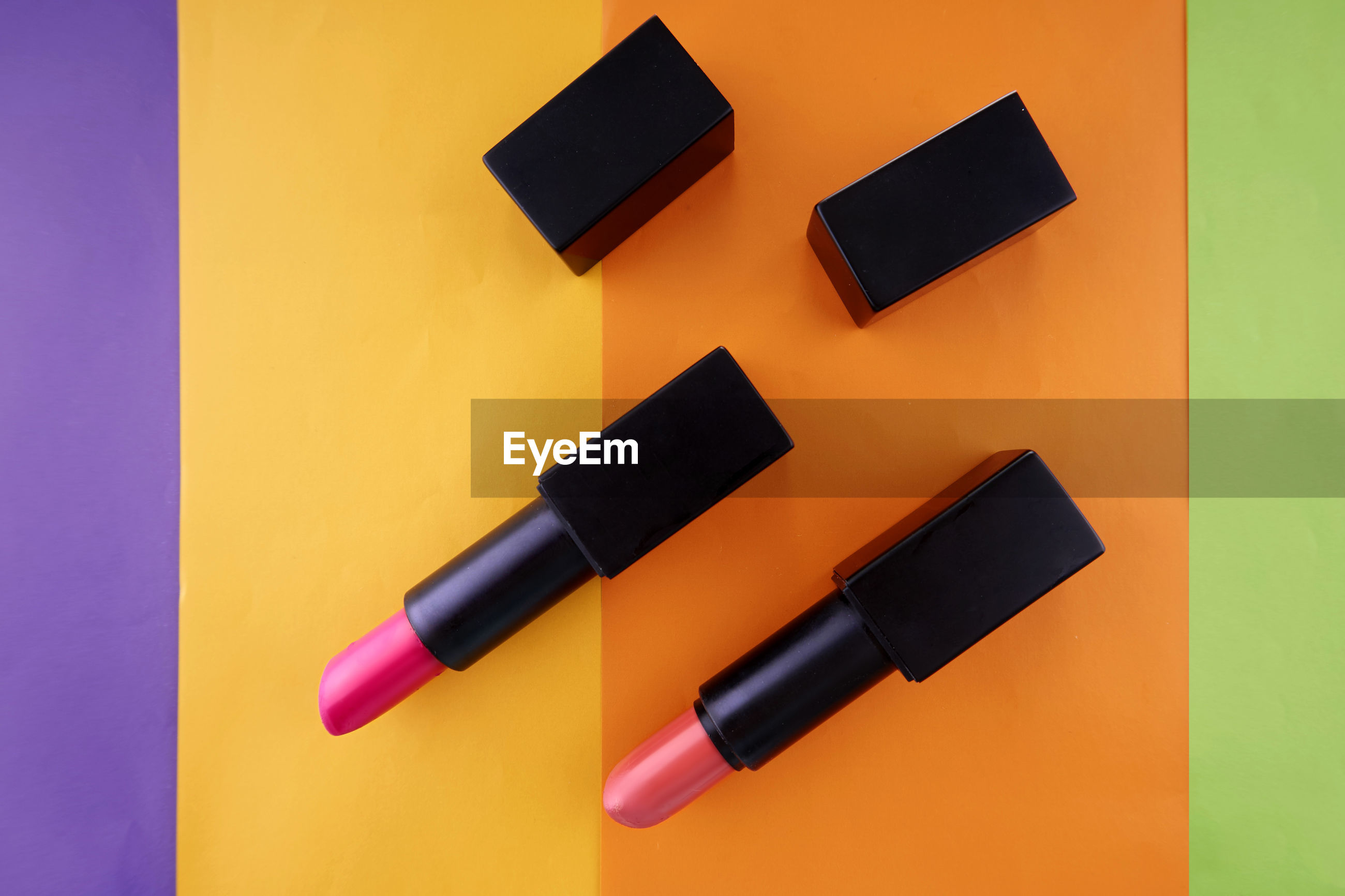 High angle view of lipstick on colored background