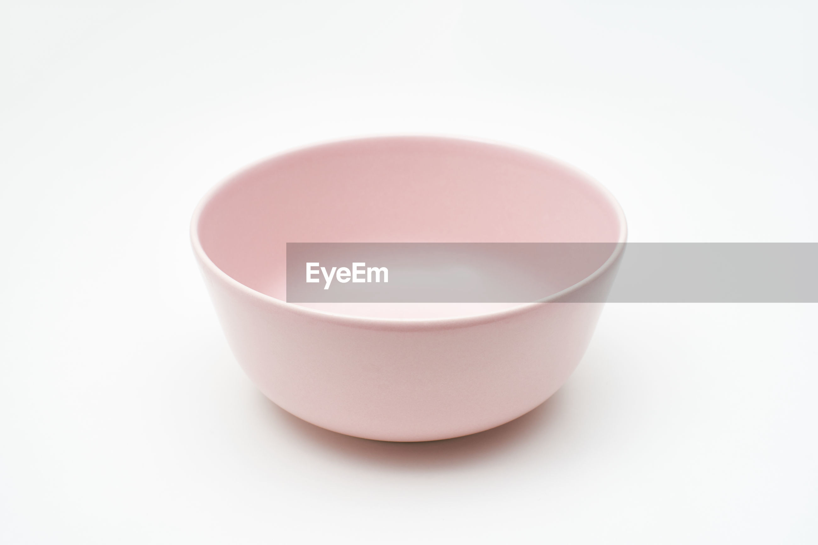 A pink bowl on white background
