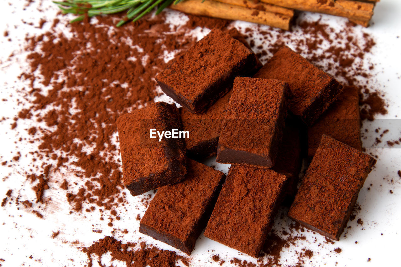 food, food and drink, chocolate, sweet food, sweet, baked, temptation, cake, freshness, dessert, indulgence, indoors, no people, close-up, brown, ready-to-eat, slice, still life, spice, unhealthy eating, chocolate cake, baked pastry item, snack