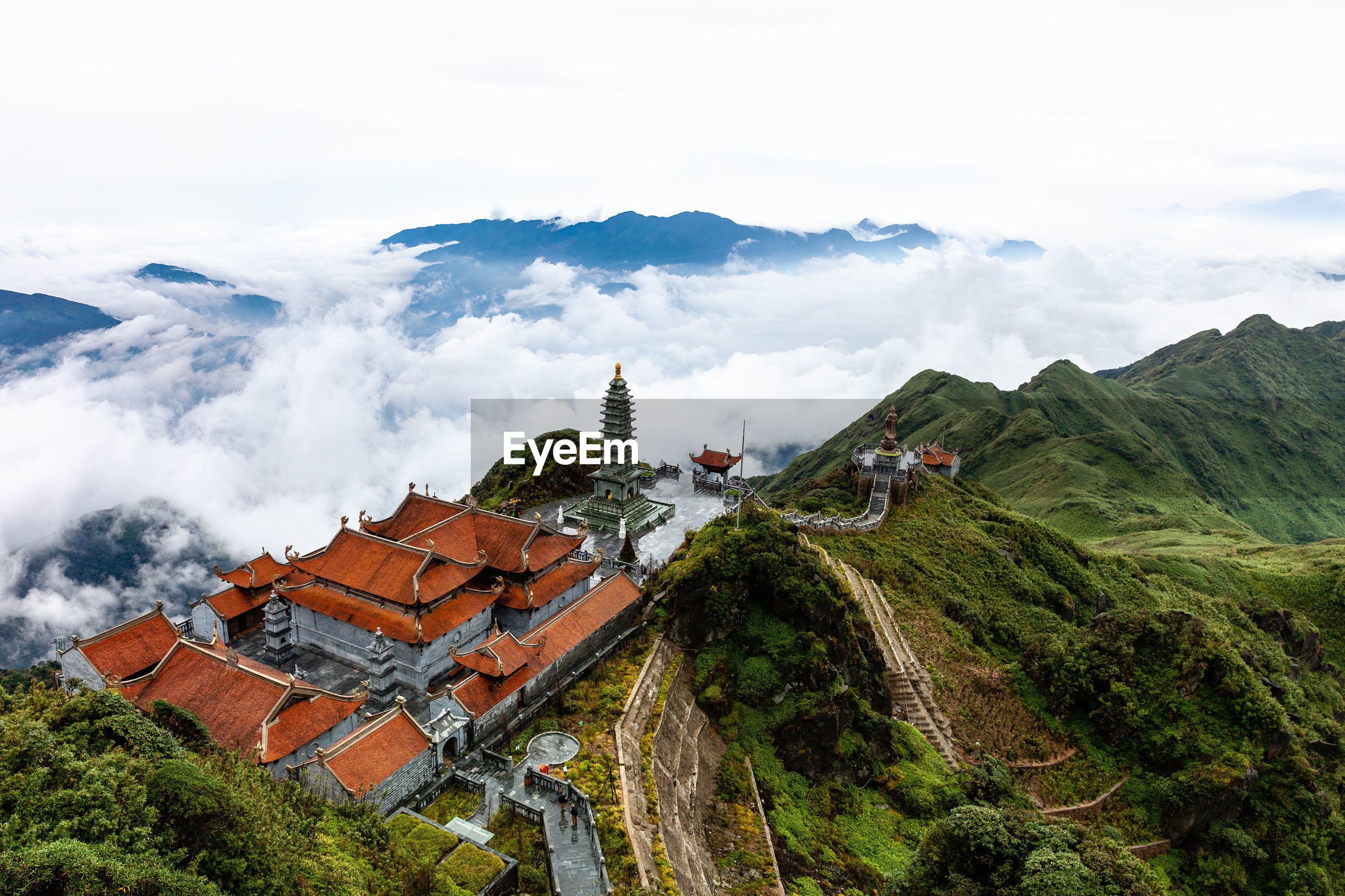 Aerial view of temple on cliff against cloudy sky