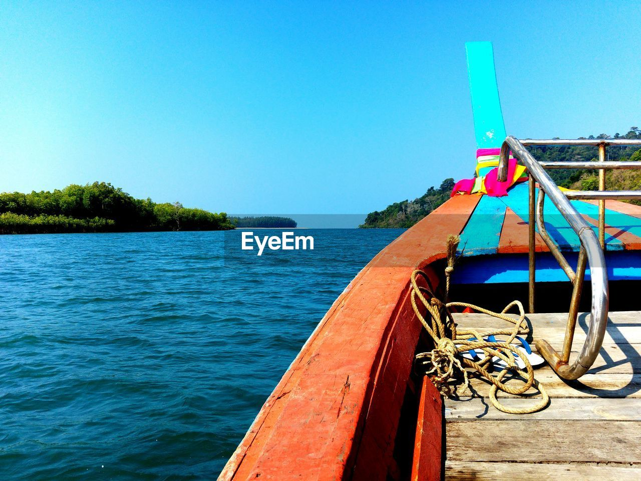 water, nautical vessel, transportation, clear sky, sky, nature, mode of transportation, blue, copy space, no people, day, rope, sea, moored, outdoors, tranquility, scenics - nature