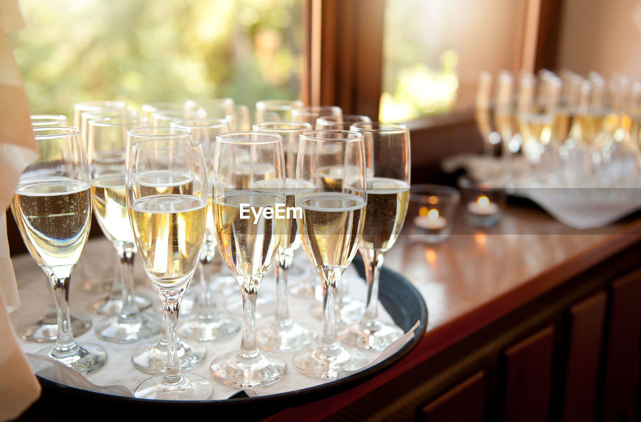 High Angle View Of Champagne Flutes On Window Sill