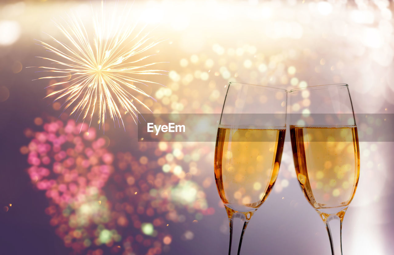 drink, refreshment, celebration, food and drink, glass, alcohol, event, wine, champagne flute, firework, champagne, no people, illuminated, freshness, household equipment, close-up, transparent, glass - material, drinking glass, focus on foreground, firework display