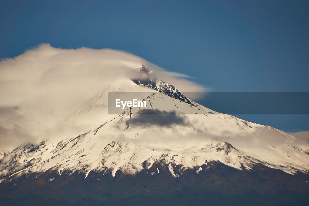mountain, snowcapped mountain, scenics - nature, sky, winter, beauty in nature, snow, tranquil scene, cold temperature, tranquility, mountain range, mountain peak, cloud - sky, nature, non-urban scene, volcano, environment, day, no people, outdoors