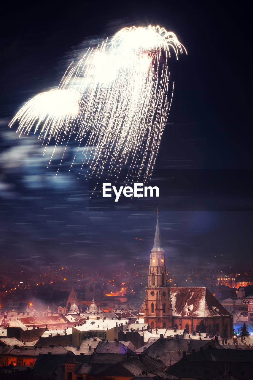 night, long exposure, illuminated, building exterior, firework display, architecture, religion, sky, blurred motion, built structure, motion, firework - man made object, outdoors, place of worship, spirituality, exploding, firework, celebration, no people, travel destinations, low angle view, cityscape, city, nature