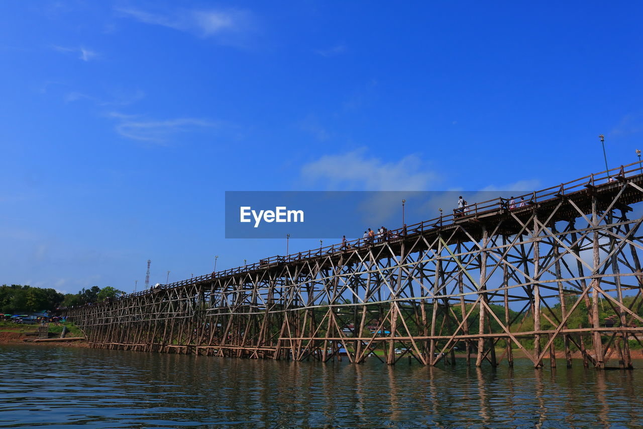 water, built structure, sky, architecture, bridge, connection, bridge - man made structure, blue, waterfront, river, nature, transportation, no people, cloud - sky, day, building exterior, outdoors, reflection, travel