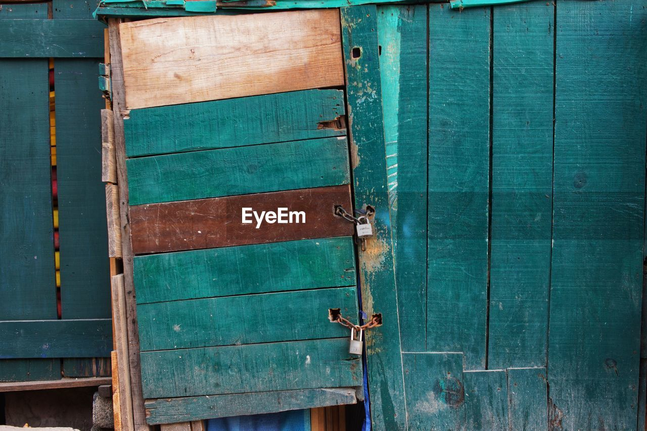 wood - material, entrance, door, backgrounds, full frame, old, green color, no people, day, closed, security, metal, safety, architecture, blue, protection, weathered, outdoors, pattern, close-up, turquoise colored, latch
