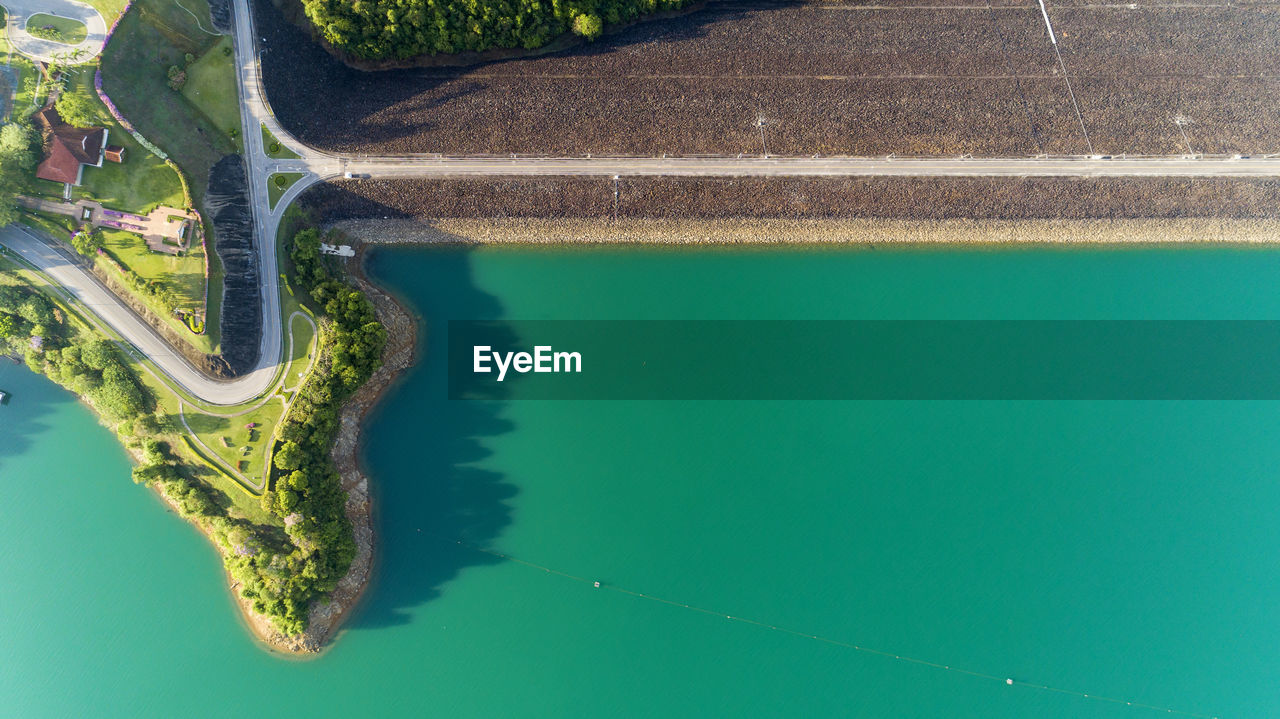 water, day, no people, nature, high angle view, reflection, green color, outdoors, aerial view, waterfront, transportation, lake, architecture, plant, tranquility, beauty in nature, tree, swimming pool