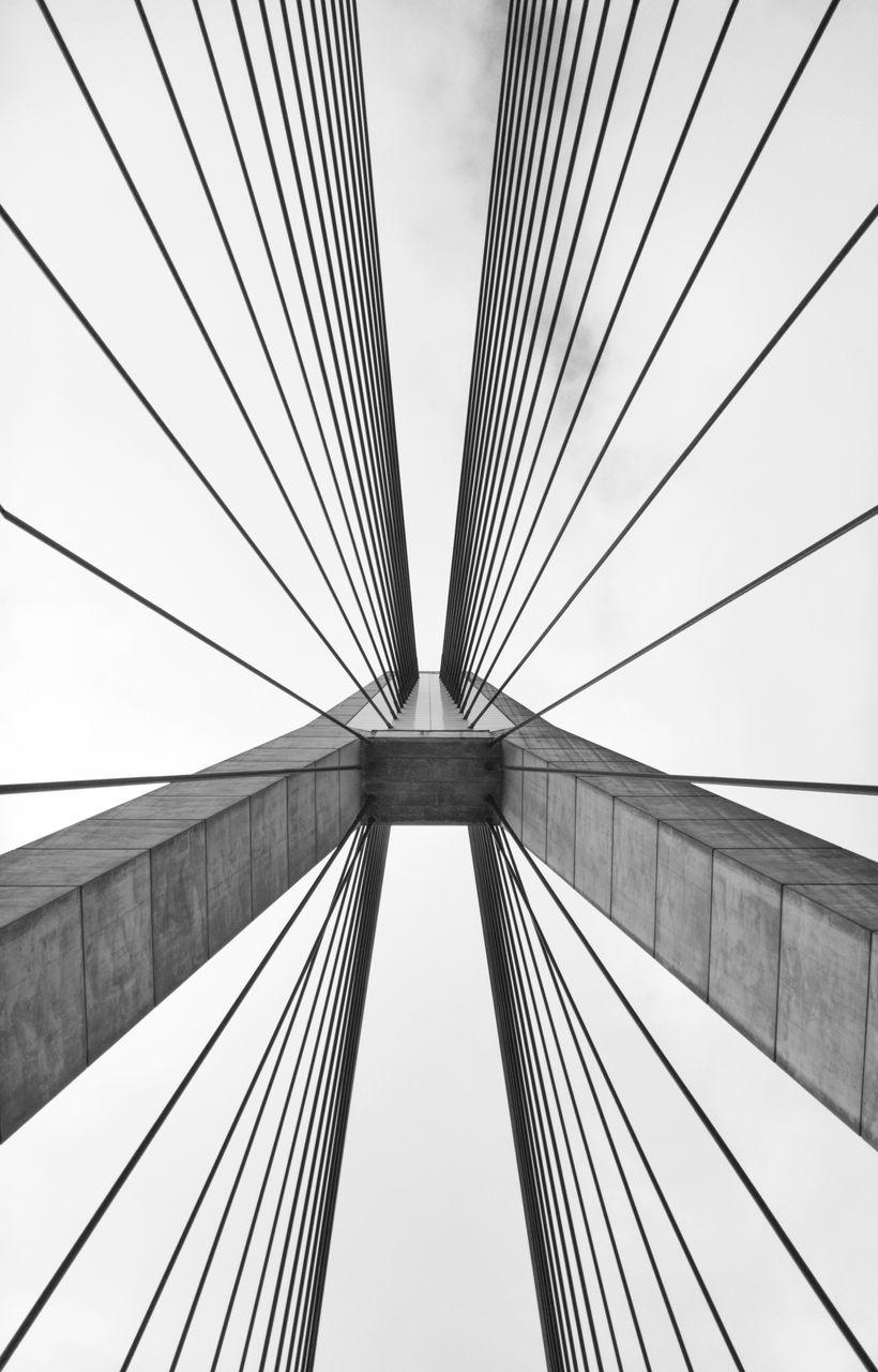 Directly Below Shot Of Suspension Bridge Against Sky