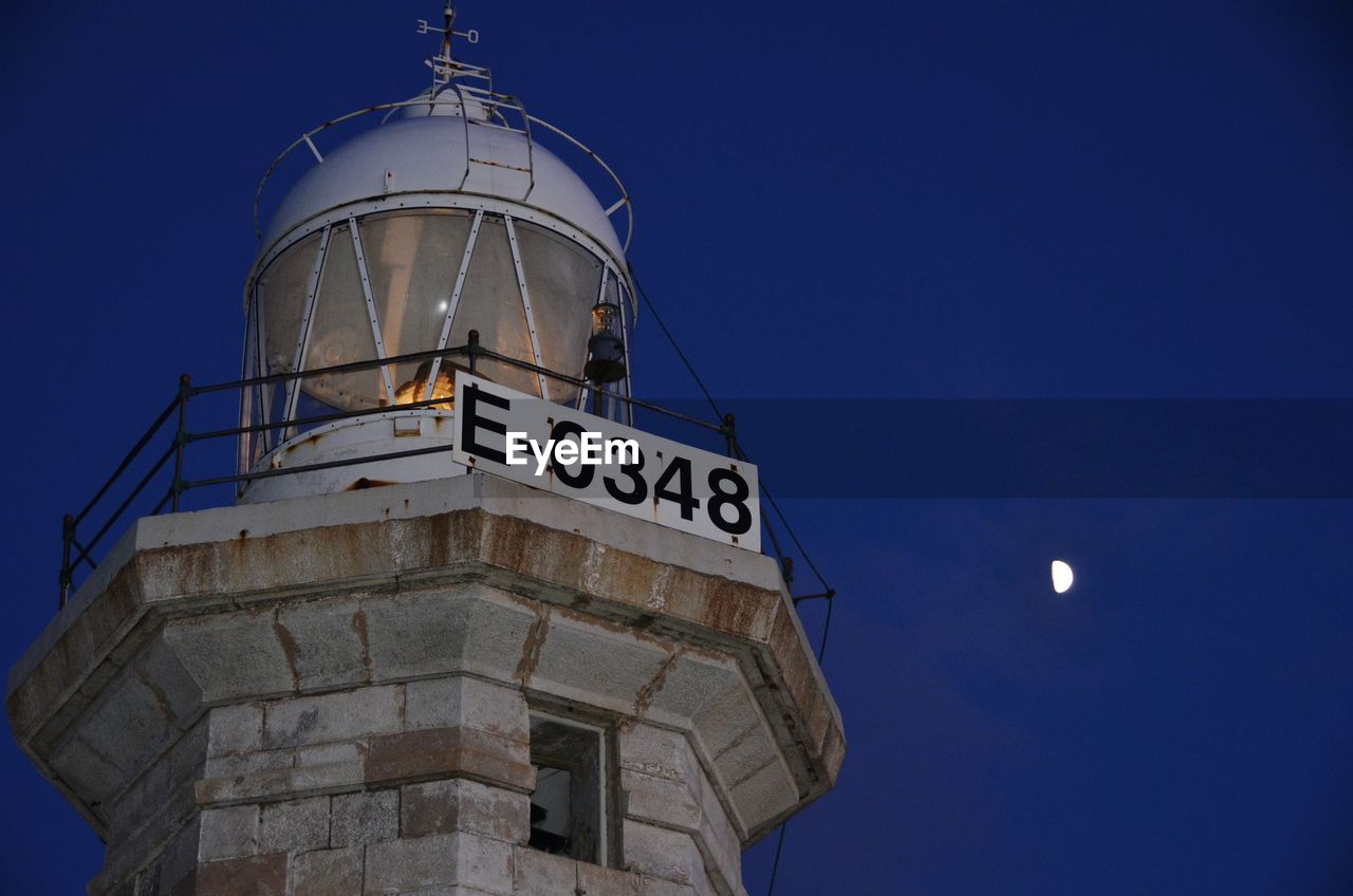 Low Angle View Of Lighthouse Against Clear Sky At Night