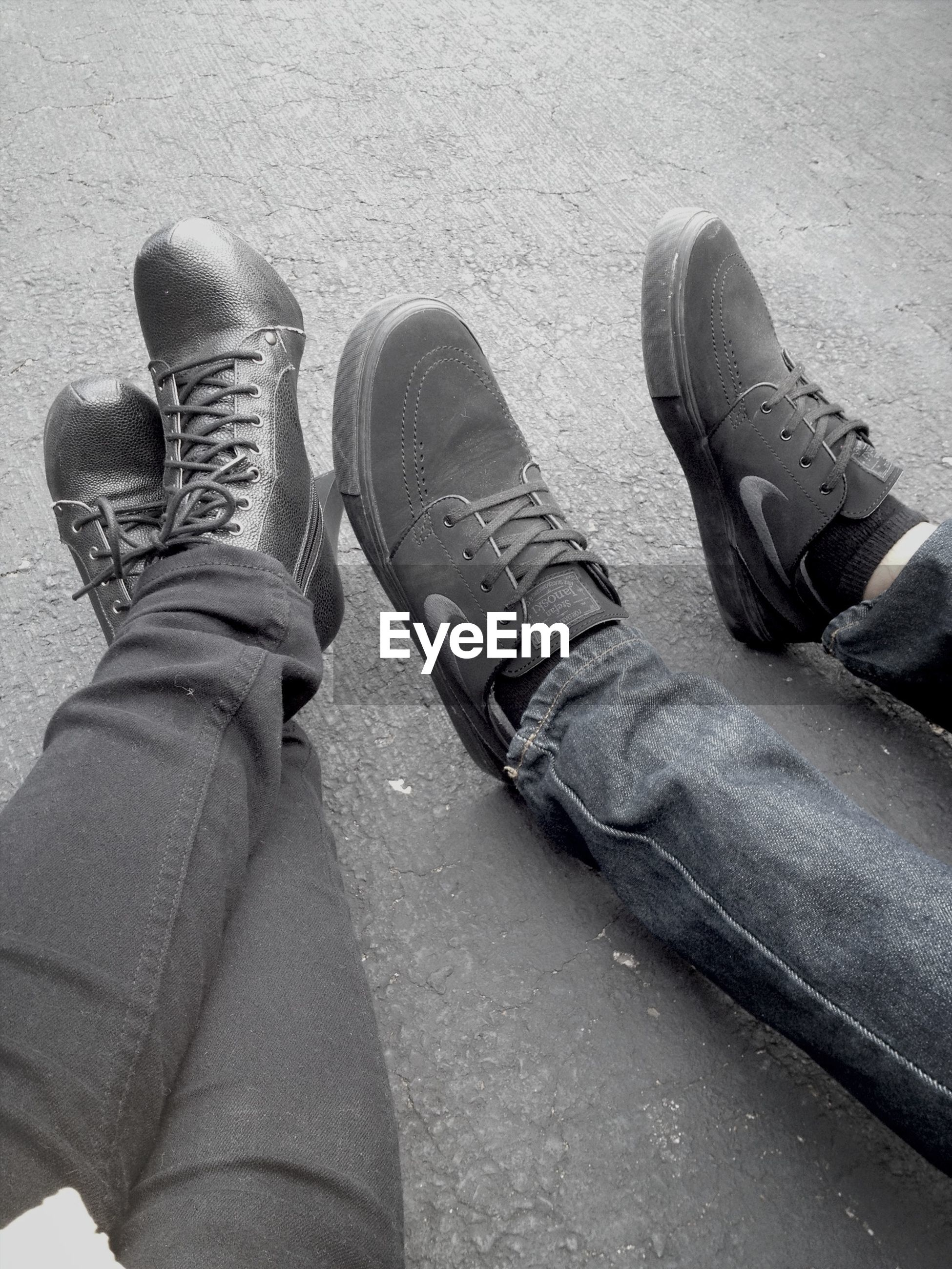low section, person, shoe, personal perspective, high angle view, footwear, human foot, street, lifestyles, standing, men, jeans, part of, unrecognizable person, leisure activity, road, canvas shoe