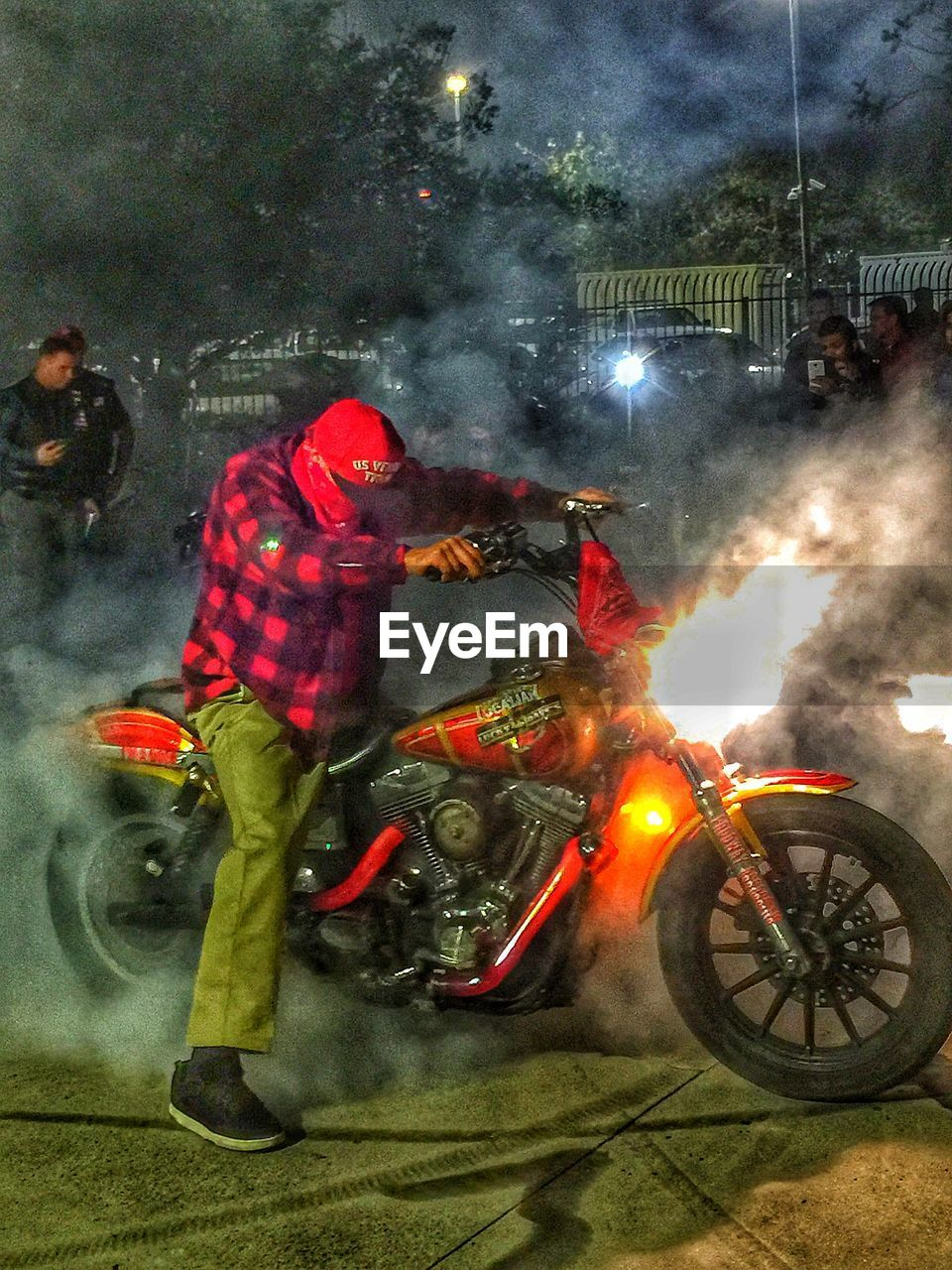 smoke - physical structure, real people, night, men, spraying, transportation, land vehicle, medium group of people, outdoors, risk, illuminated, protective workwear, firefighter, adult, people