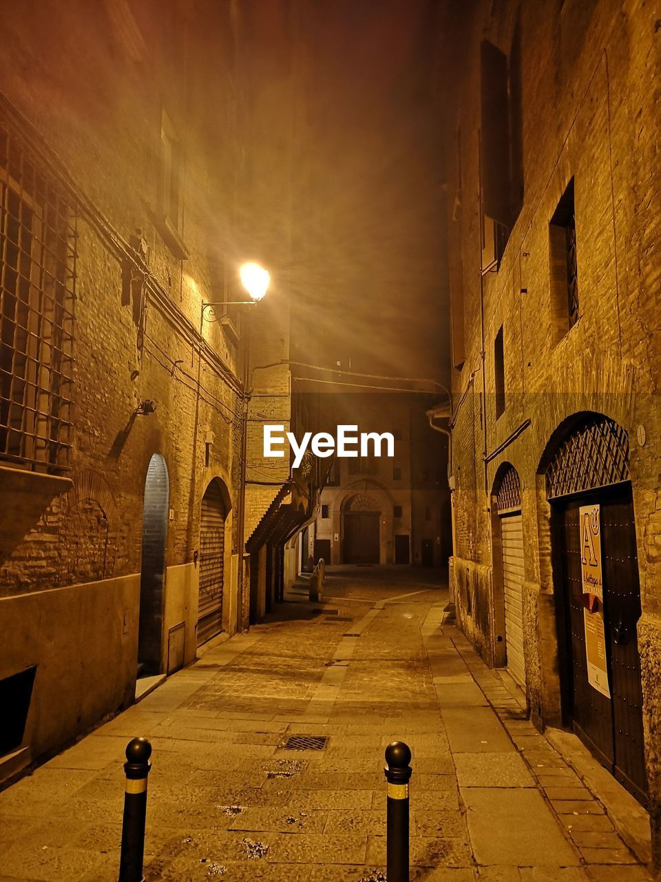 architecture, building exterior, built structure, street, building, illuminated, city, direction, the way forward, night, lighting equipment, street light, no people, arch, history, the past, old, residential district, outdoors, footpath, alley