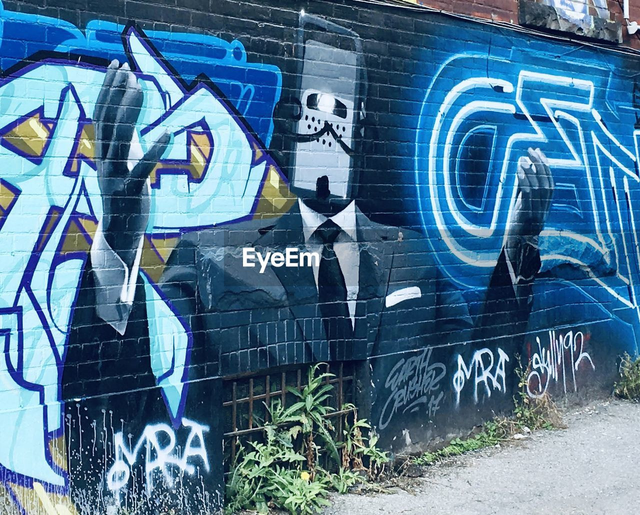 graffiti, text, creativity, art and craft, western script, architecture, wall - building feature, built structure, no people, street art, communication, day, multi colored, city, building exterior, representation, outdoors, human representation, capital letter, mural, message