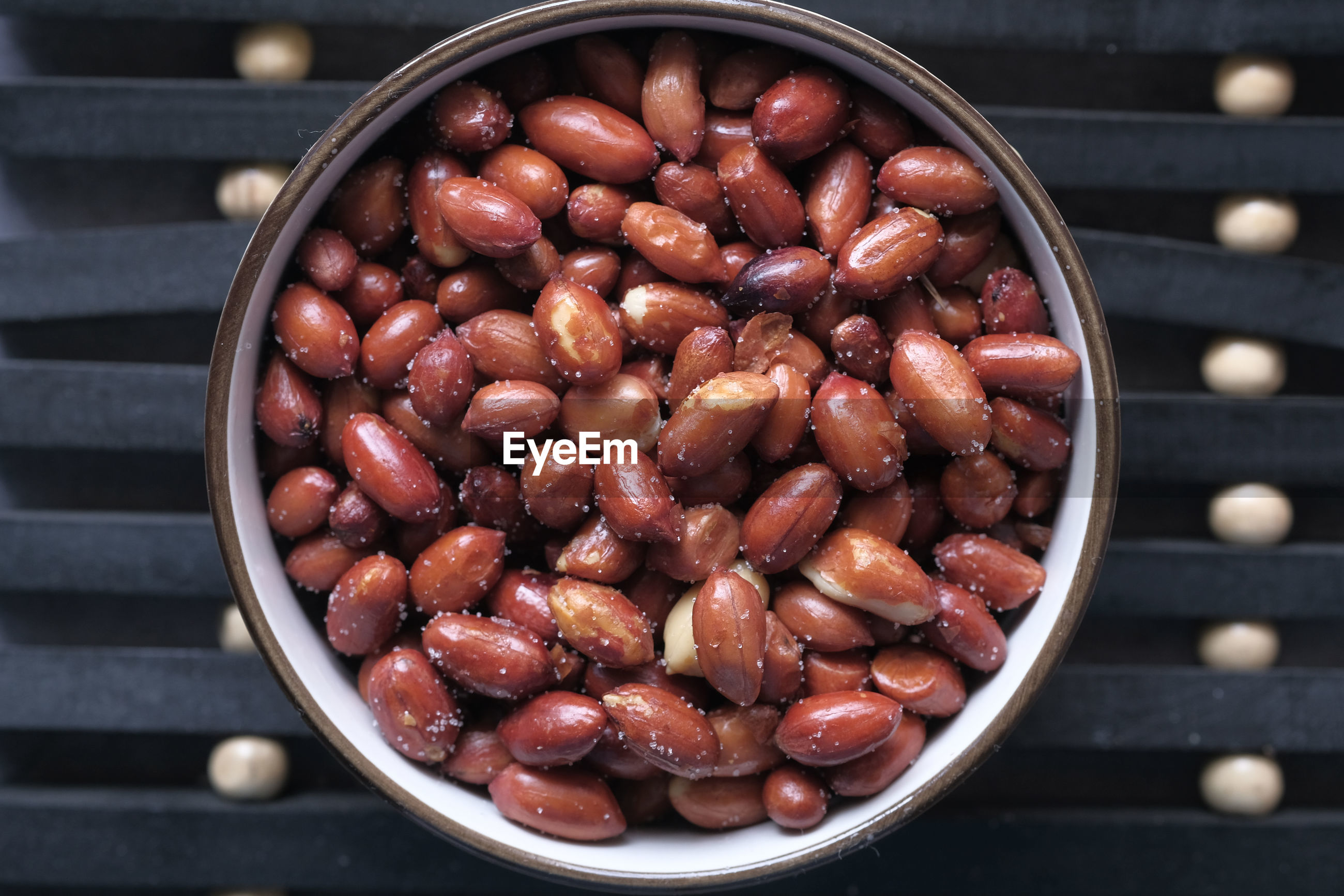 Top view of fresh pea nut in a bowl on table