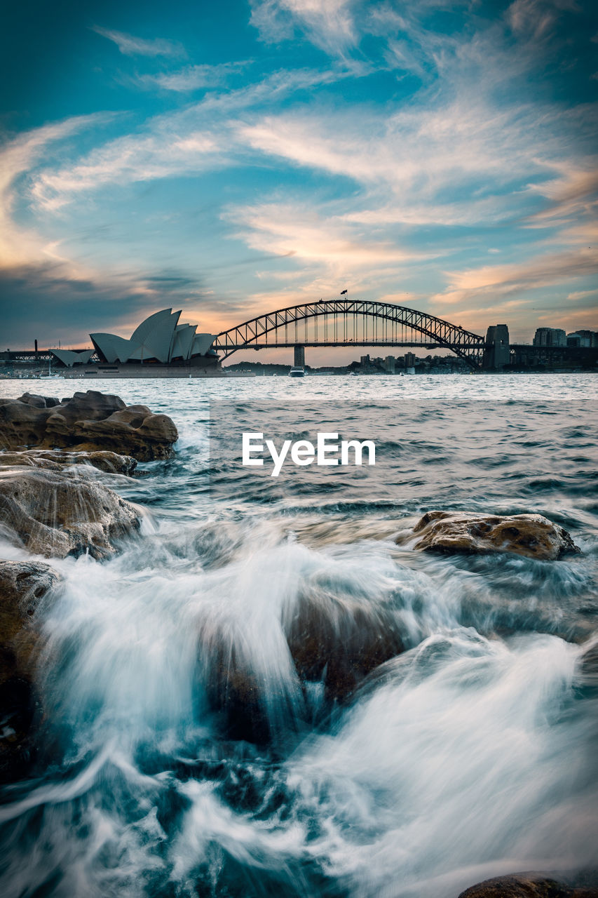 water, bridge, built structure, sky, connection, bridge - man made structure, cloud - sky, architecture, sea, motion, waterfront, nature, long exposure, transportation, no people, travel destinations, city, outdoors, flowing water, bay, power in nature, flowing