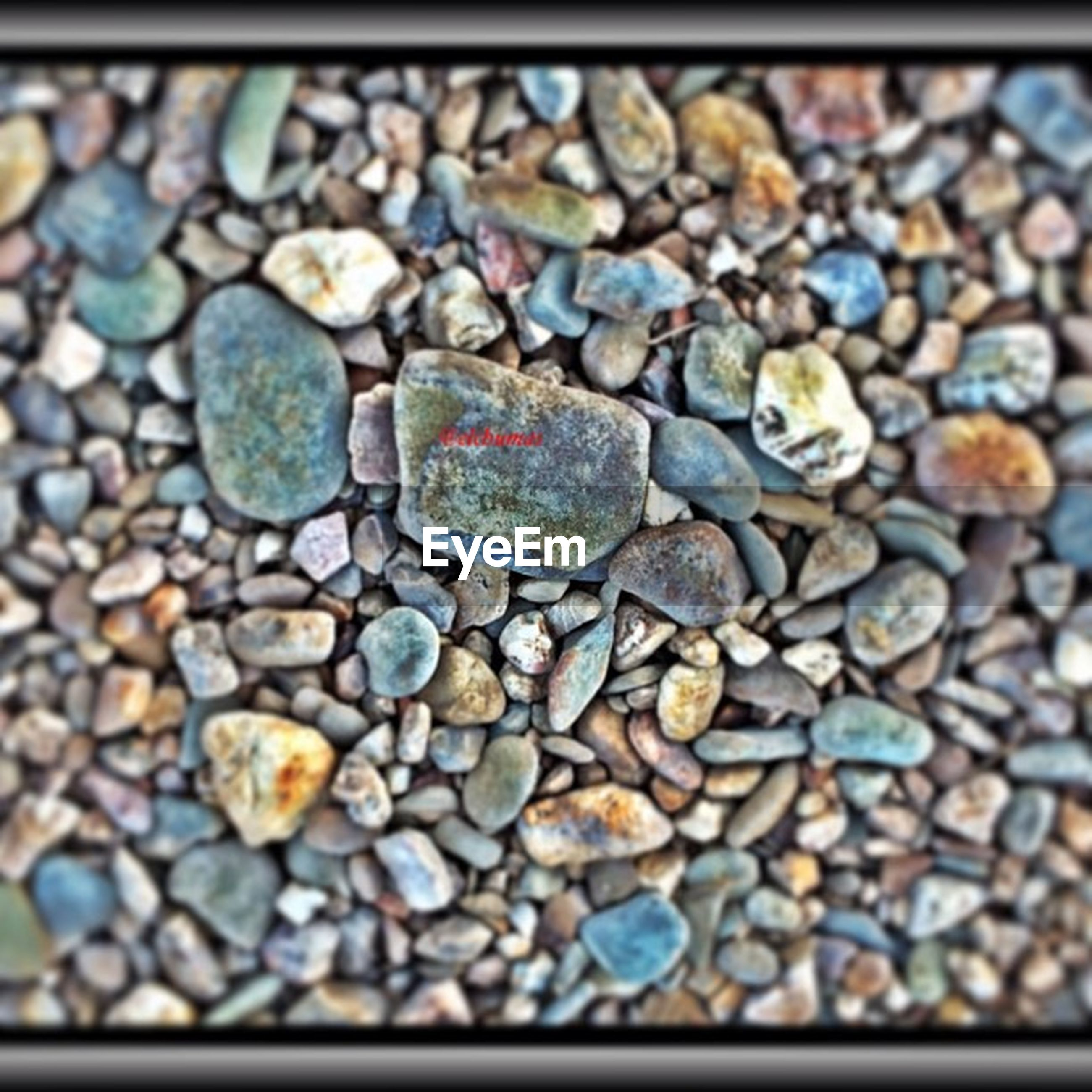 pebble, abundance, large group of objects, full frame, backgrounds, stone - object, transfer print, close-up, selective focus, auto post production filter, textured, high angle view, surface level, no people, day, outdoors, still life, stone, heap, nature