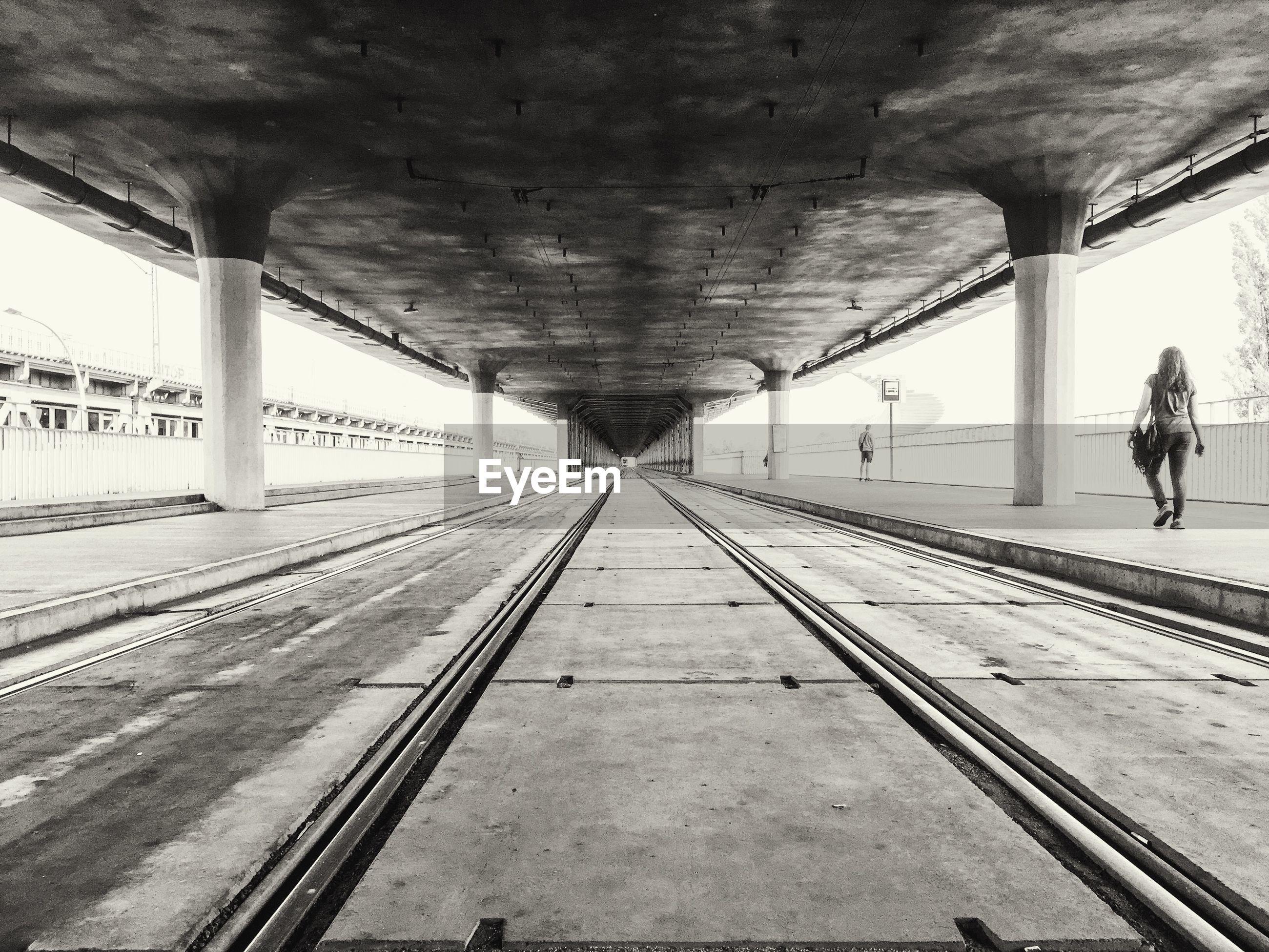 Railroad tracks below bridge