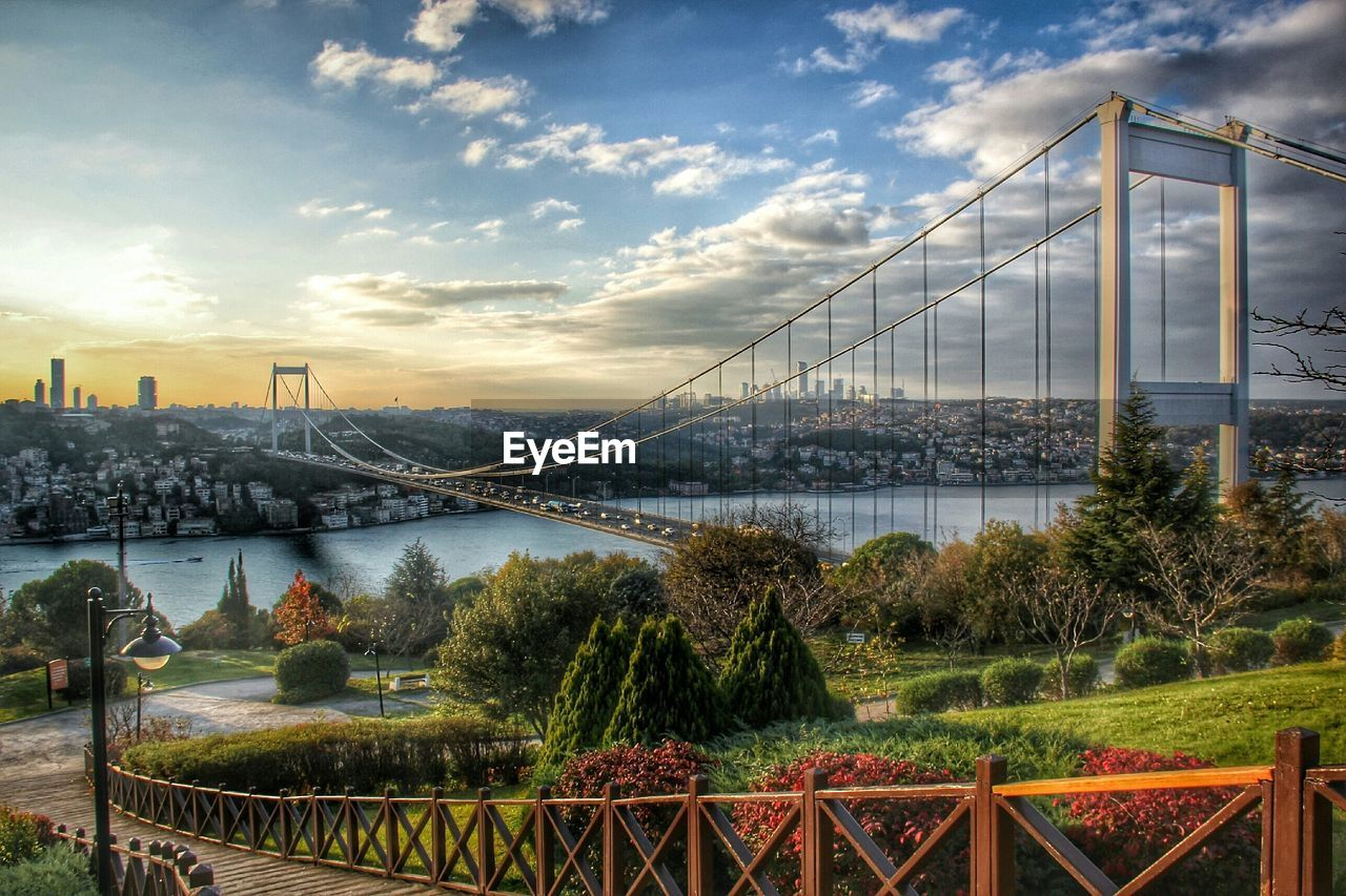 Bosphorus bridge over river against sky