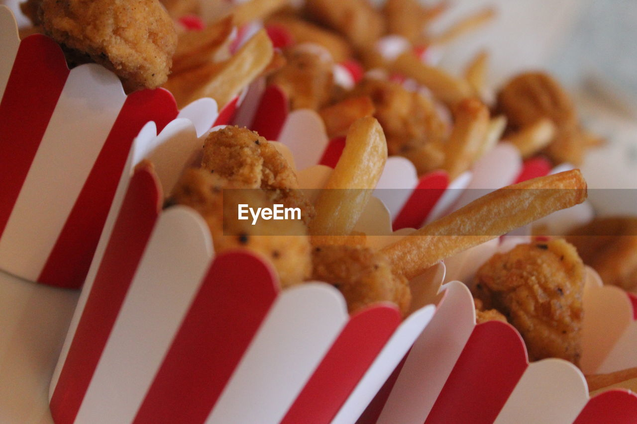 Close-up of fried chicken and fries