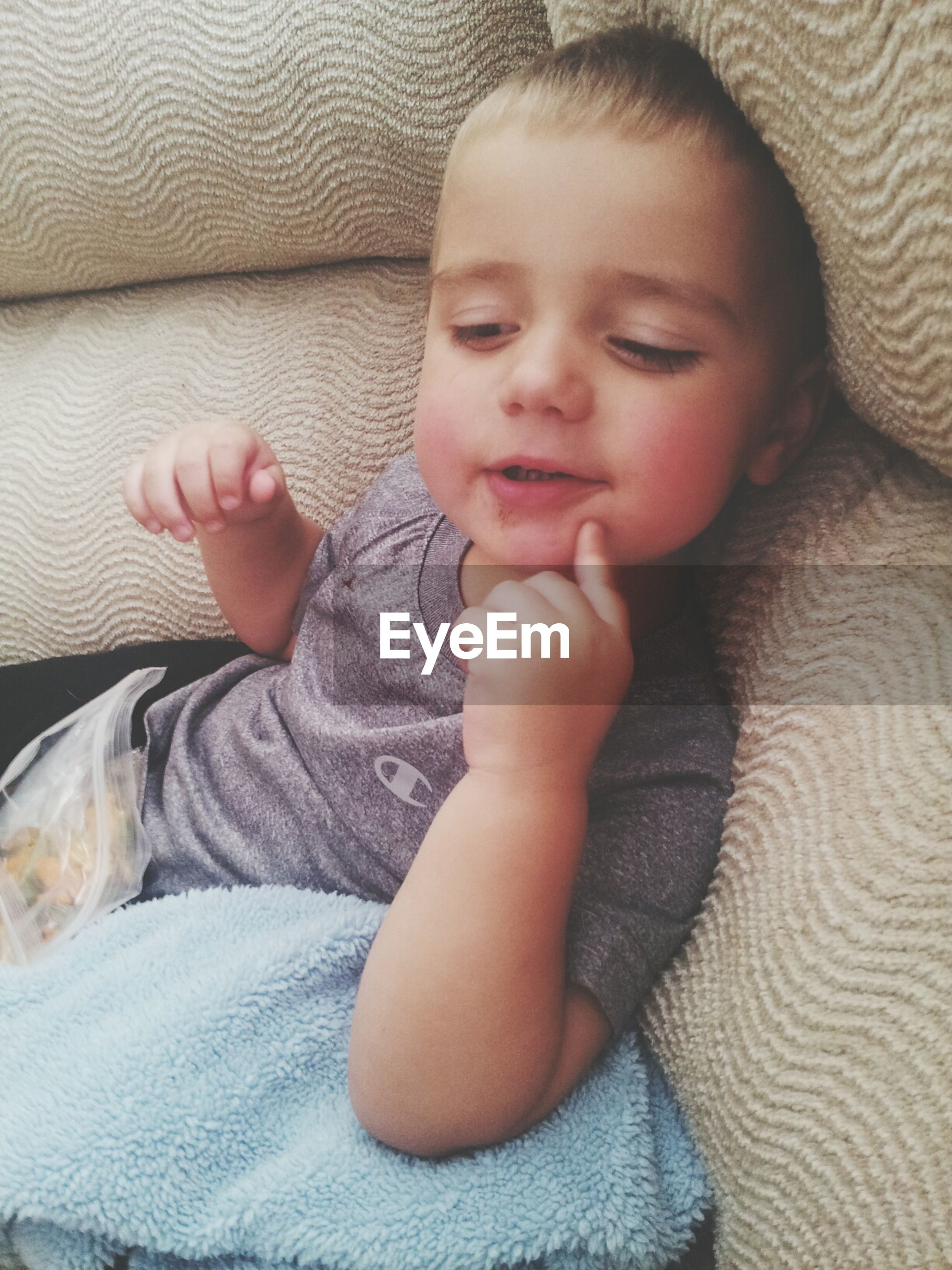 indoors, childhood, relaxation, person, bed, innocence, baby, babyhood, cute, toddler, casual clothing, lifestyles, home interior, lying down, sleeping, elementary age, resting, leisure activity