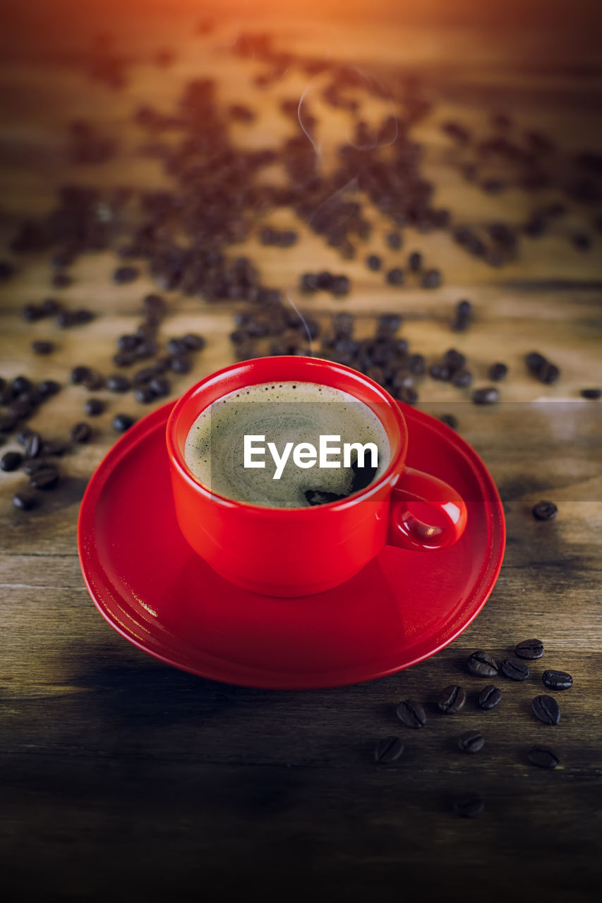 food and drink, drink, refreshment, cup, table, mug, coffee, coffee - drink, still life, freshness, indoors, crockery, coffee cup, food, hot drink, saucer, no people, frothy drink, close-up, red, non-alcoholic beverage