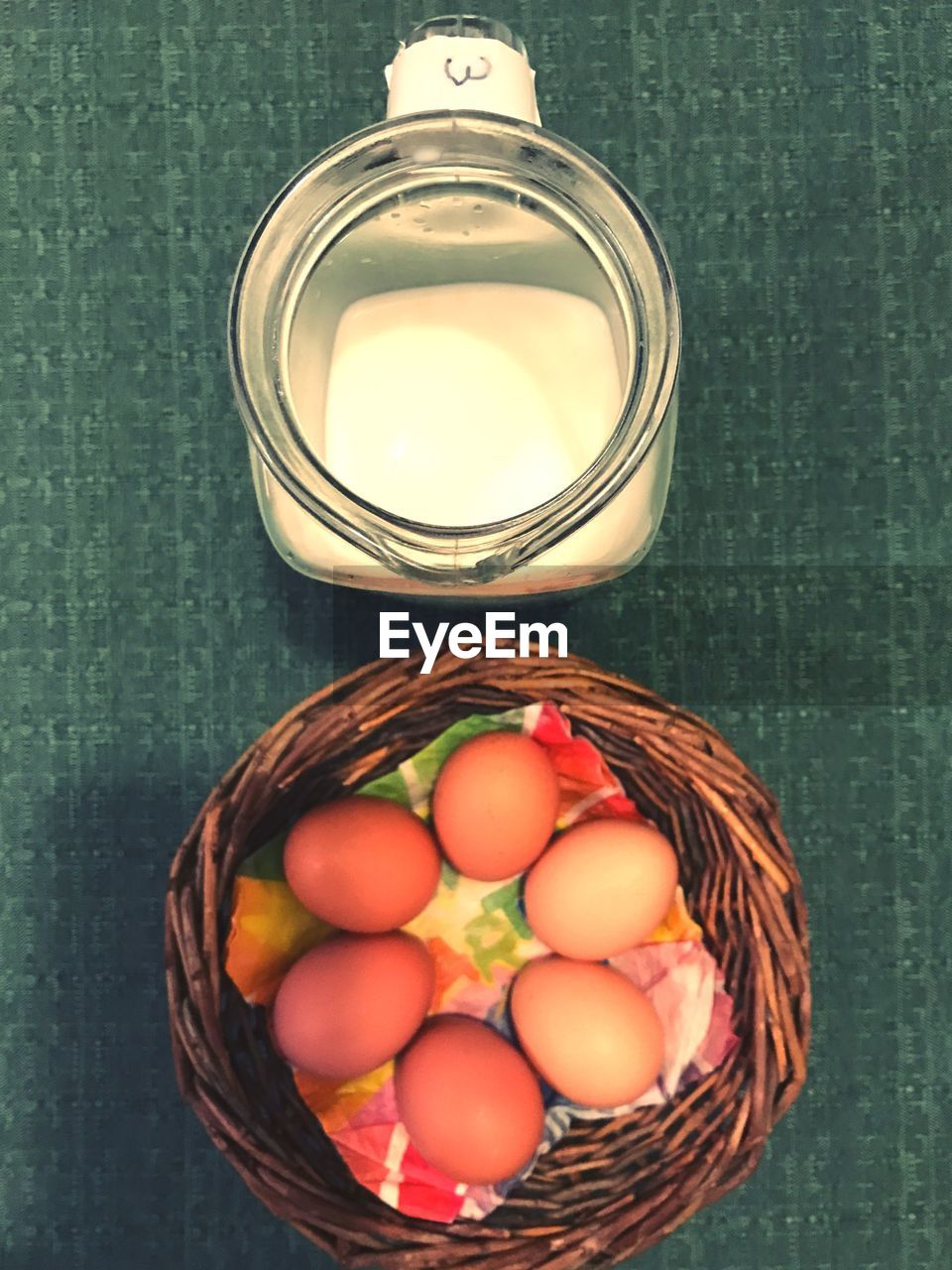 container, food, food and drink, egg, basket, freshness, indoors, wellbeing, still life, table, no people, high angle view, wicker, healthy eating, directly above, multi colored, glass - material, close-up, celebration