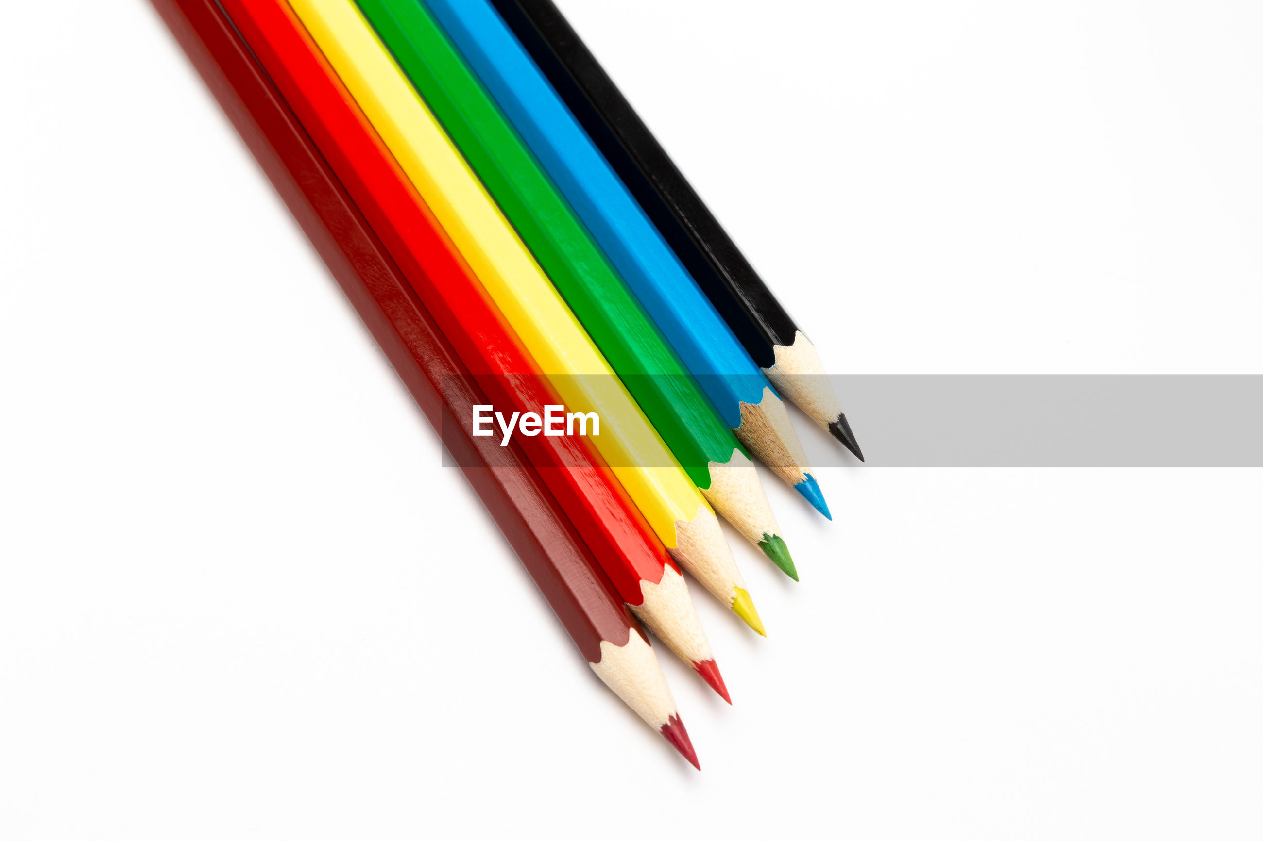 MULTI COLORED PENCILS ON WHITE BACKGROUND
