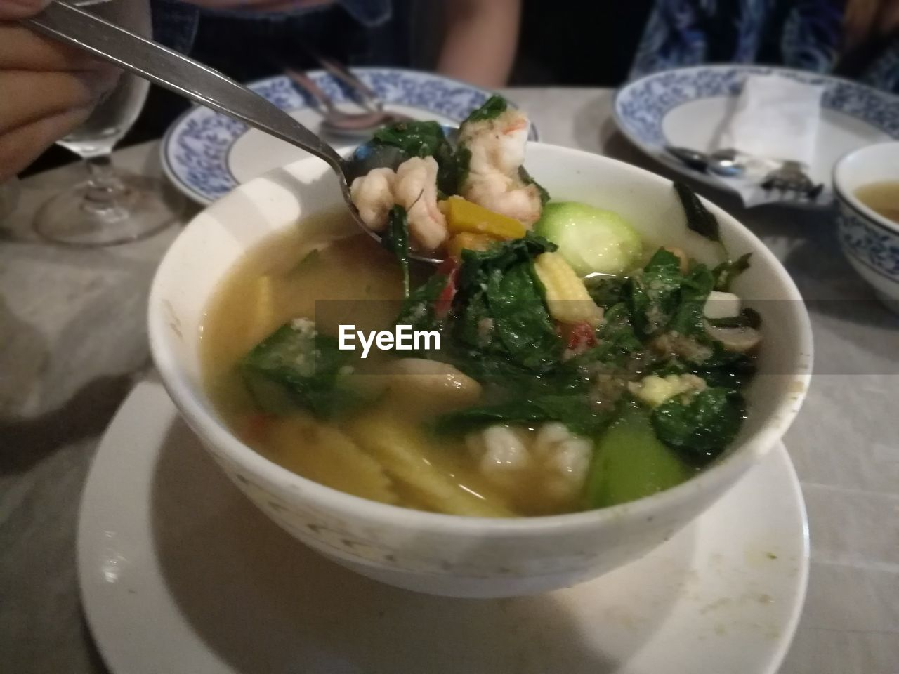 food and drink, food, bowl, healthy eating, freshness, soup, table, one person, serving size, vegetable, indoors, ready-to-eat, real people, human hand, healthy lifestyle, plate, holding, close-up, chopsticks, human body part, vegetable soup, day, people