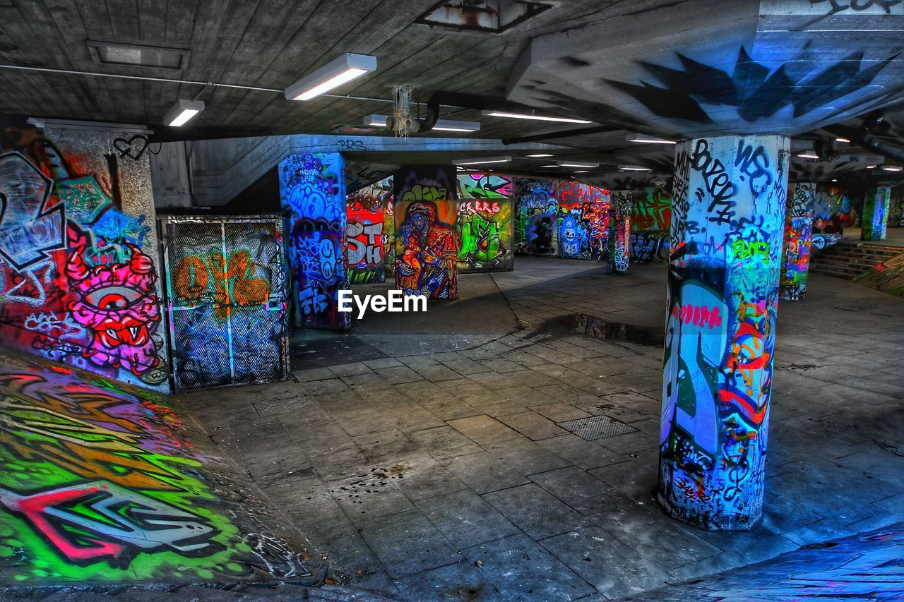 multi colored, graffiti, colorful, architecture, illuminated, street art, no people, the way forward, built structure, indoors, day