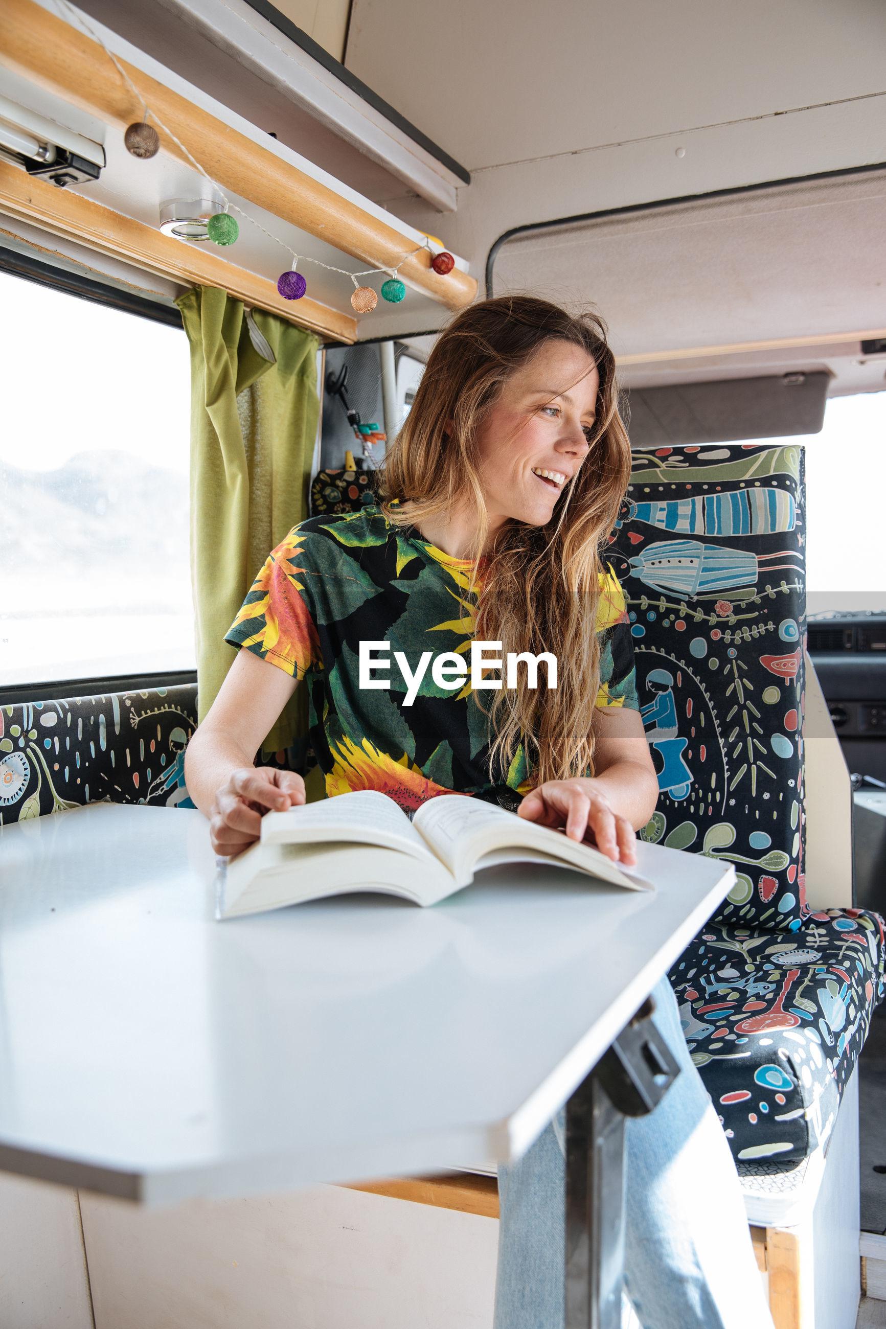 Woman traveling in camper van