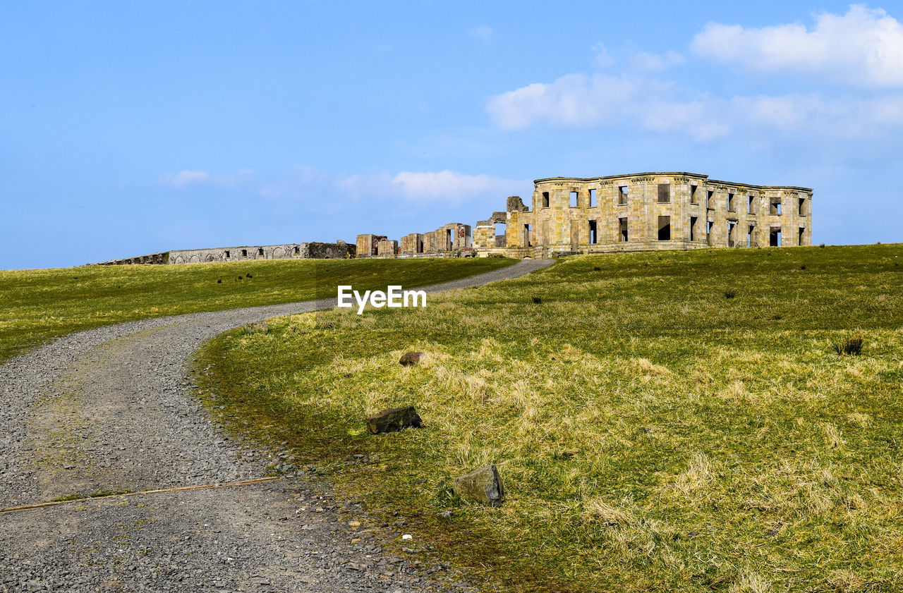 Low angle view of Downhill House against sky