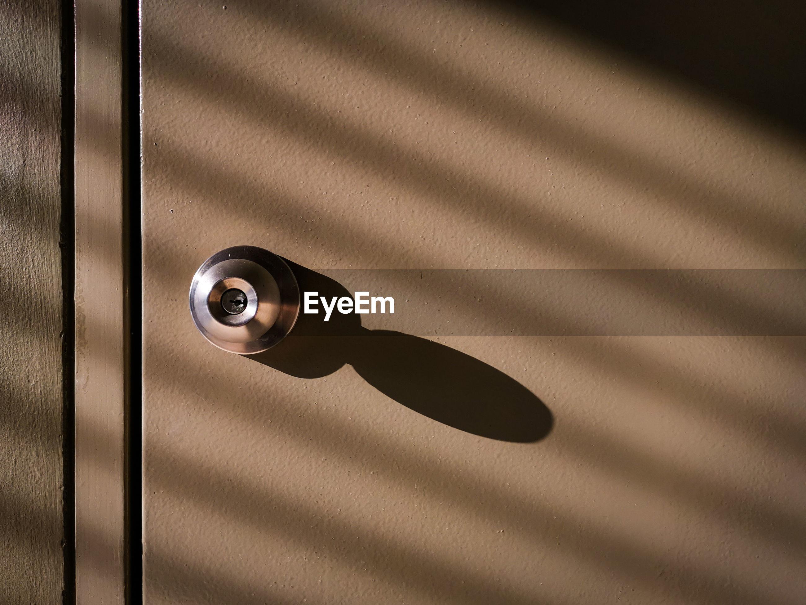 Brown steel door knob light and shadows in the evening