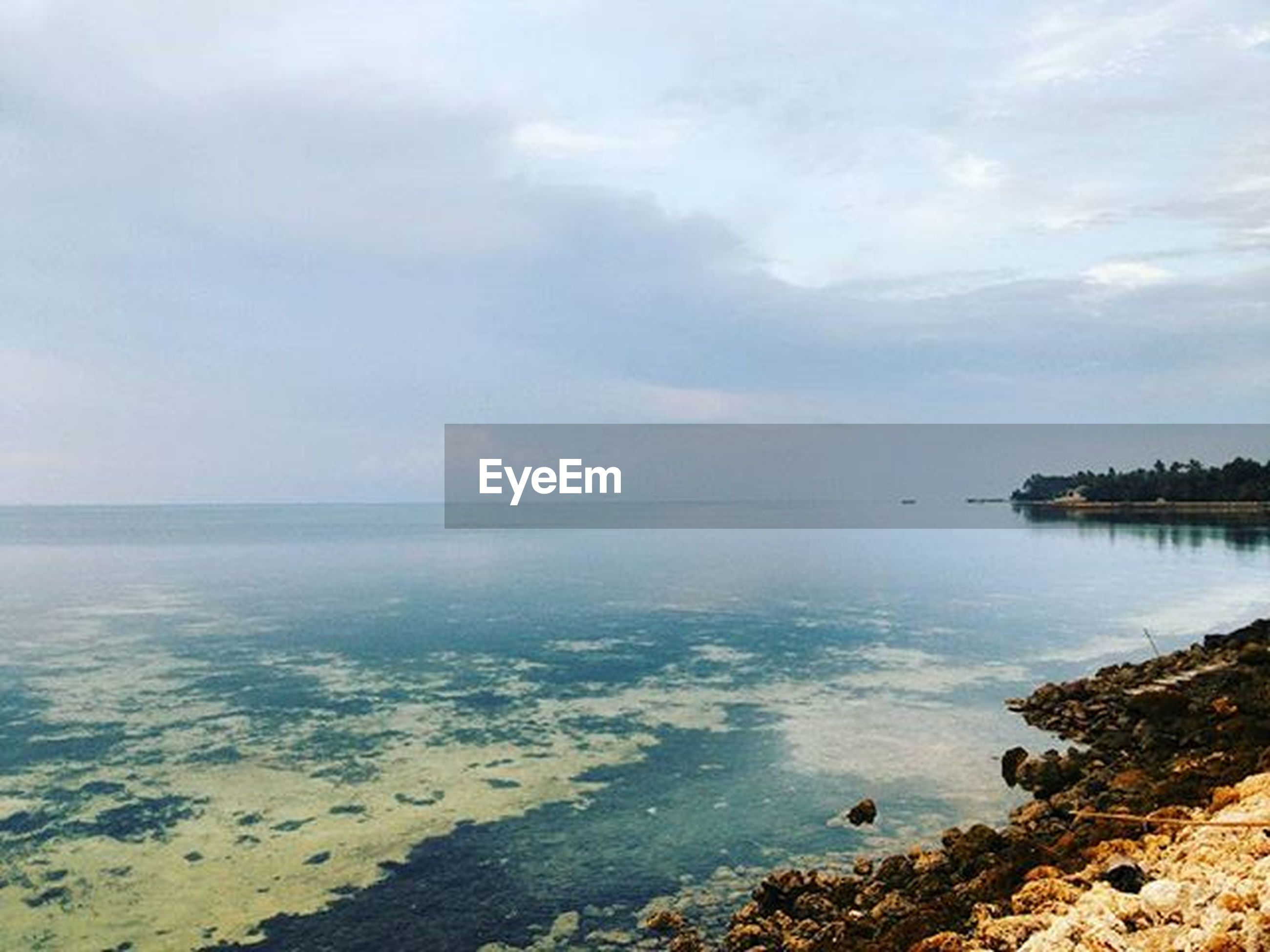 water, sea, beach, sky, tranquil scene, tranquility, scenics, horizon over water, shore, beauty in nature, nature, cloud - sky, idyllic, coastline, sand, cloud, calm, remote, rock - object, outdoors