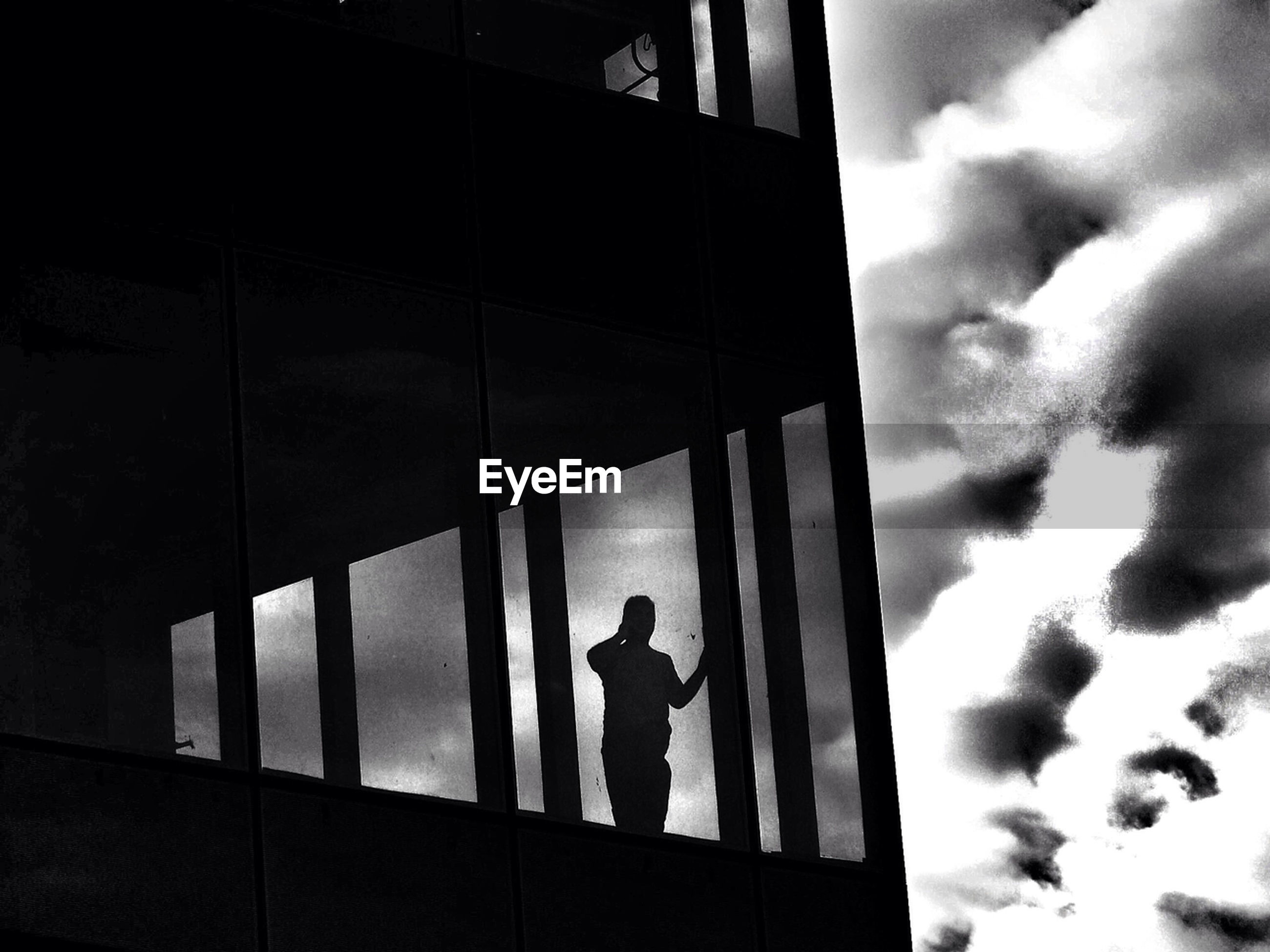 Silhouette of man standing in office building