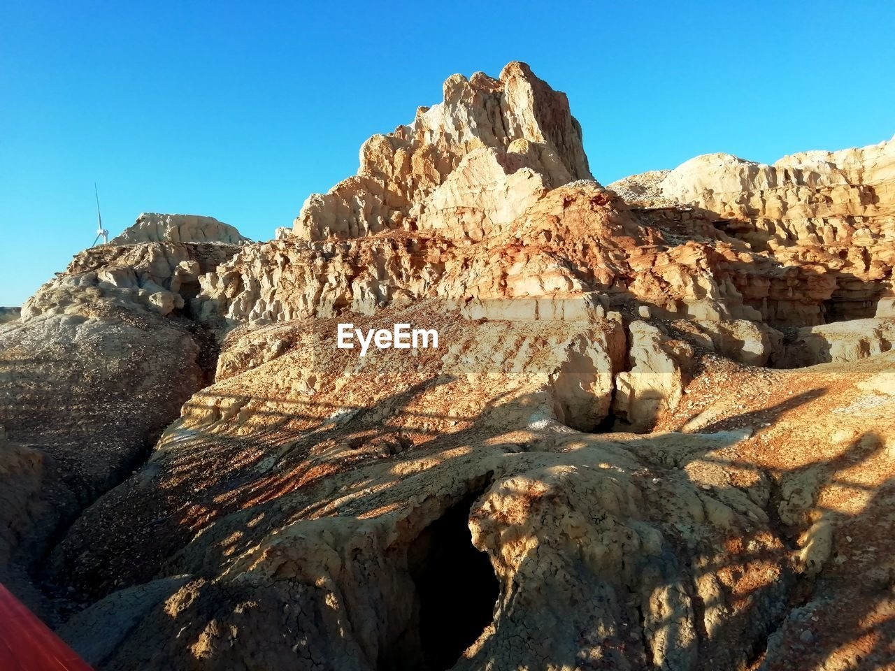 rock, rock - object, sky, solid, rock formation, geology, nature, physical geography, clear sky, scenics - nature, beauty in nature, tranquil scene, tranquility, no people, mountain, sunlight, day, non-urban scene, rough, blue, eroded, mountain range, formation, outdoors, arid climate, climate, mountain peak
