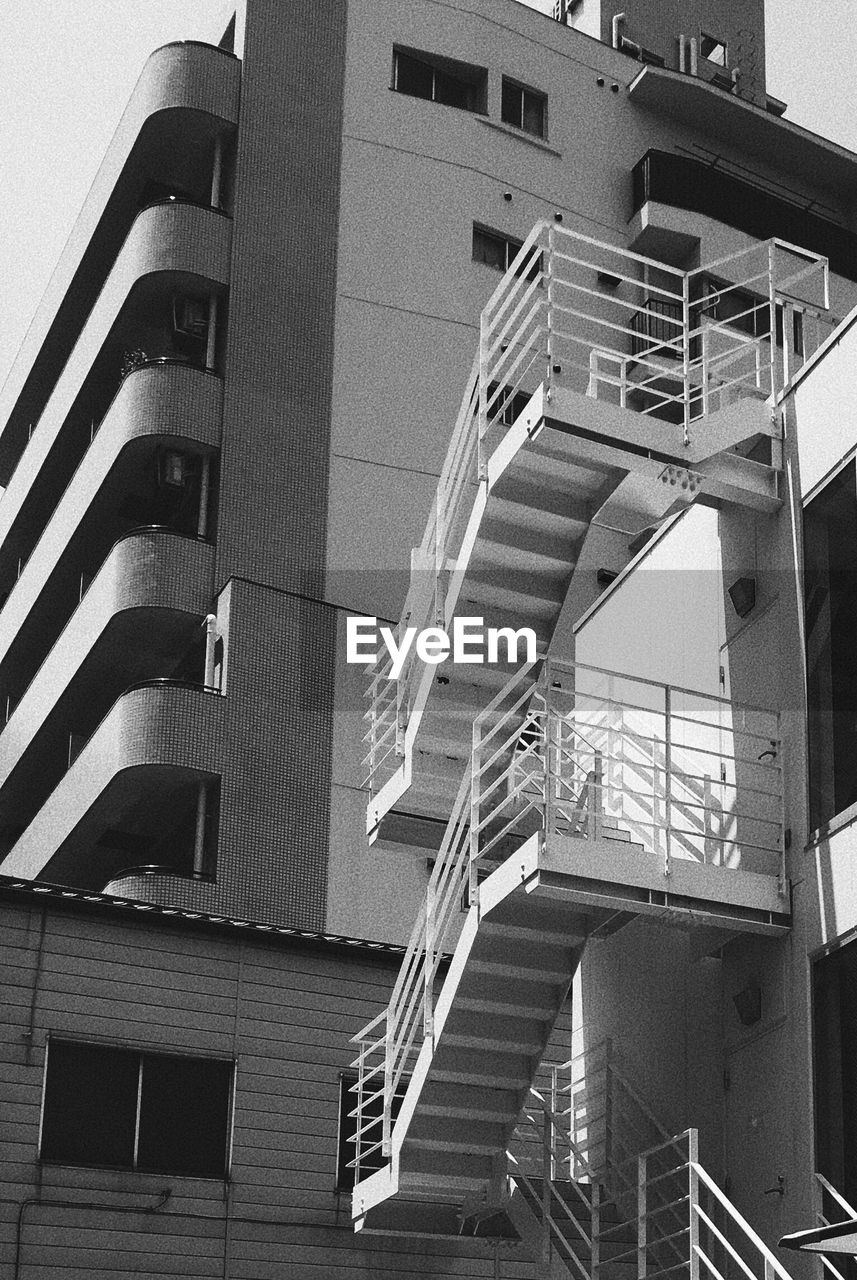 architecture, built structure, staircase, building exterior, steps and staircases, steps, low angle view, railing, window, fire escape, no people, day, outdoors