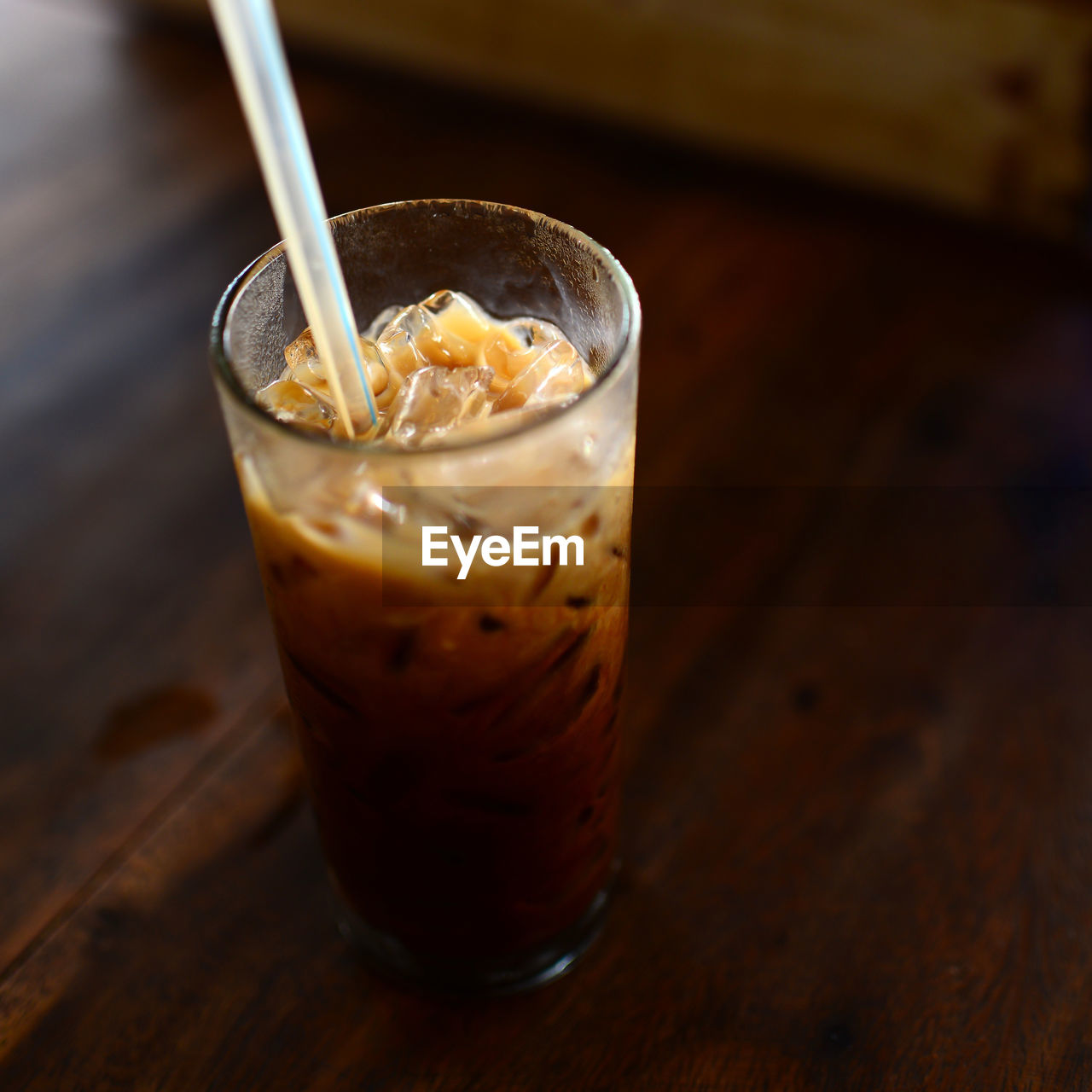 drink, food and drink, refreshment, coffee - drink, table, freshness, focus on foreground, iced coffee, indoors, close-up, high angle view, no people, drinking glass, drinking straw, day