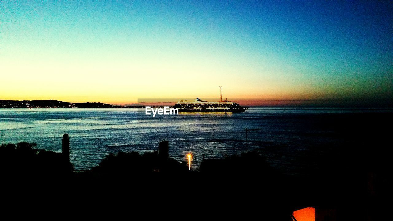 sea, water, clear sky, sunset, nautical vessel, transportation, nature, silhouette, outdoors, horizon over water, waterfront, tranquility, no people, mode of transport, beauty in nature, sky, scenics, oil industry, offshore platform, day, drilling rig, oil pump