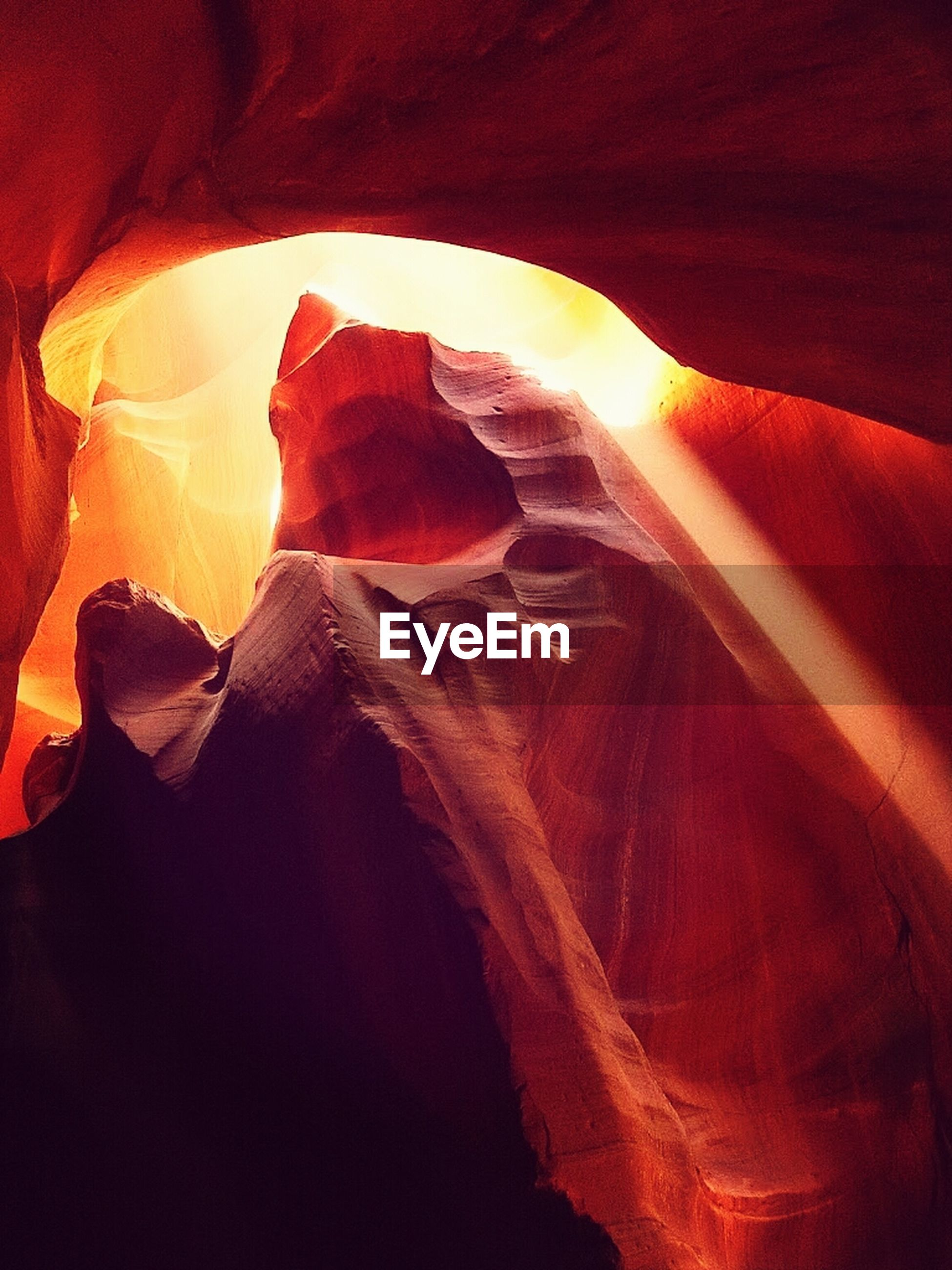 indoors, red, sunlight, close-up, no people, orange color, nature, sunbeam, tranquility, day, lens flare, rock - object, rock formation, beauty in nature, sun, geology, cave, natural pattern, light - natural phenomenon, high angle view