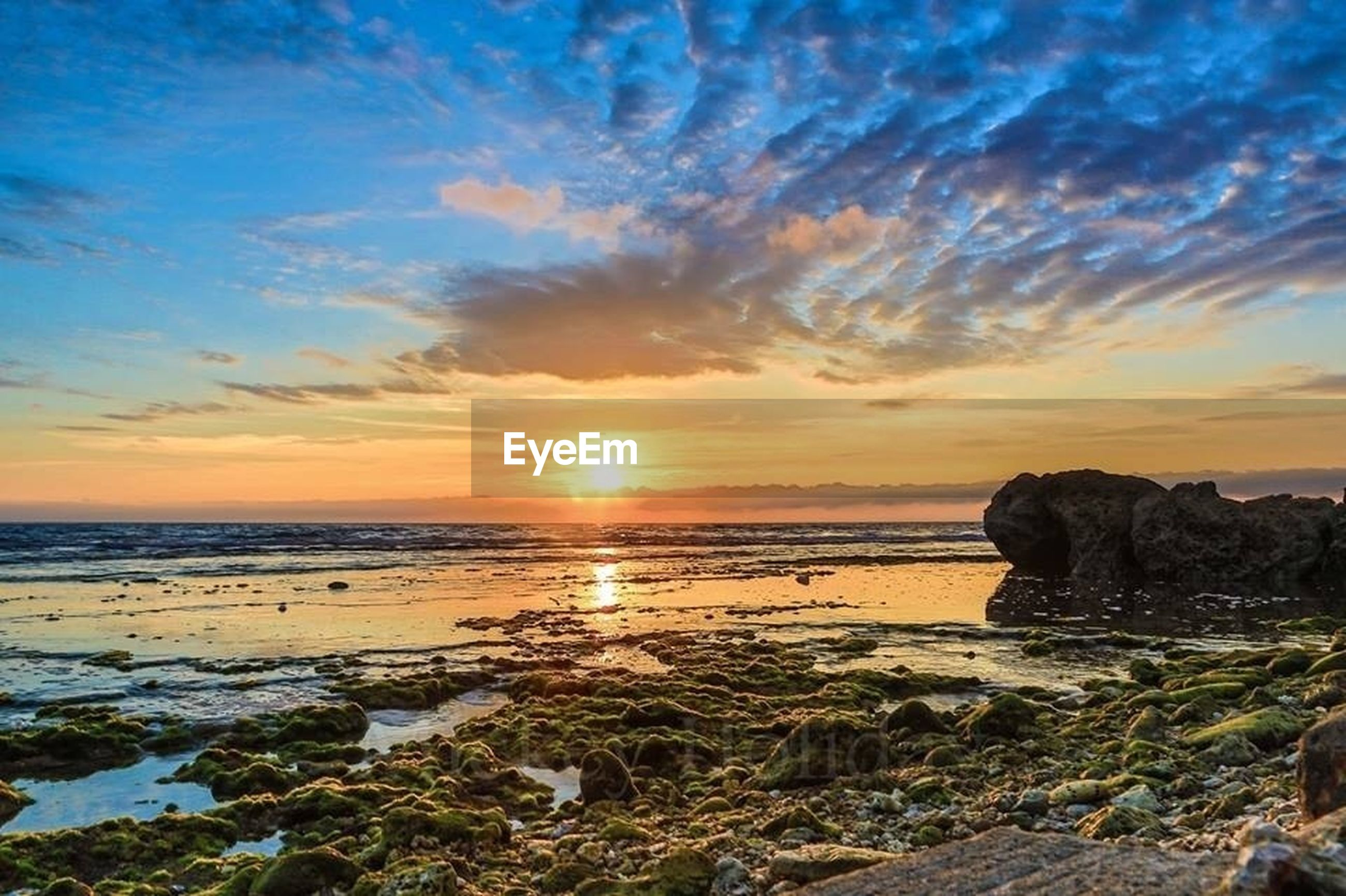 sunset, sea, scenics, water, tranquil scene, sky, beauty in nature, tranquility, beach, horizon over water, shore, sun, nature, cloud - sky, rock - object, idyllic, orange color, cloud, sunlight, non-urban scene